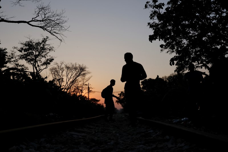 A group of Central American migrants rest along the railway track on their way to the United States in Macuspana, Tabasco, Mexico March 25, 2021. REUTERS/Carlos Jasso