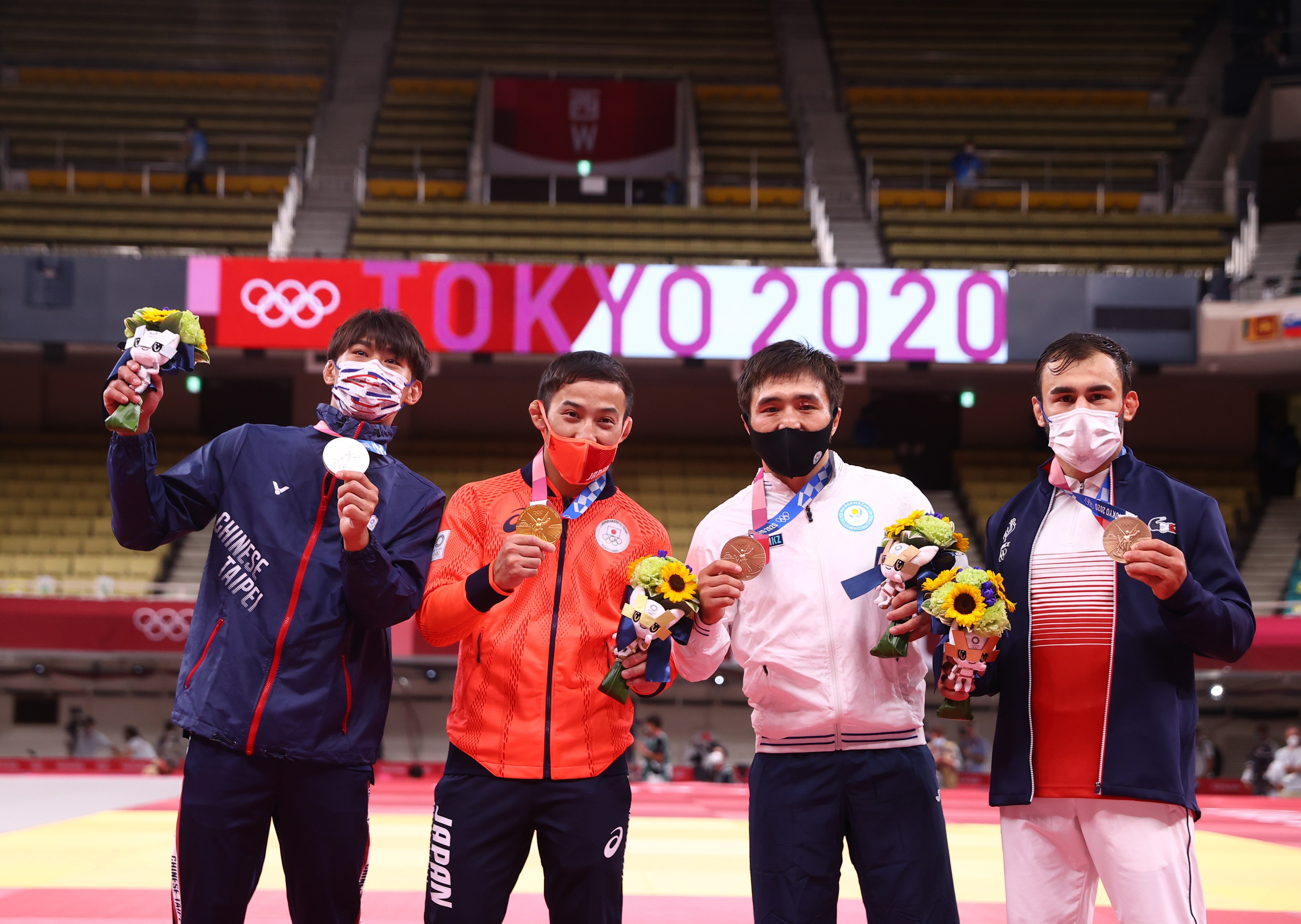 Tokyo 2020 Olympics - Judo - Men's 60kg - Medal Ceremony - Nippon Budokan - Tokyo, Japan - July 24, 2021. Gold medallist Naohisa Takato of Japan poses for a picture with silver medallist Yang Yung Wei of Taiwan, bronze medallist Yeldos Smetov of Kazakhstan, and bronze medallist Luka Mkheidze of France REUTERS/Sergio Perez