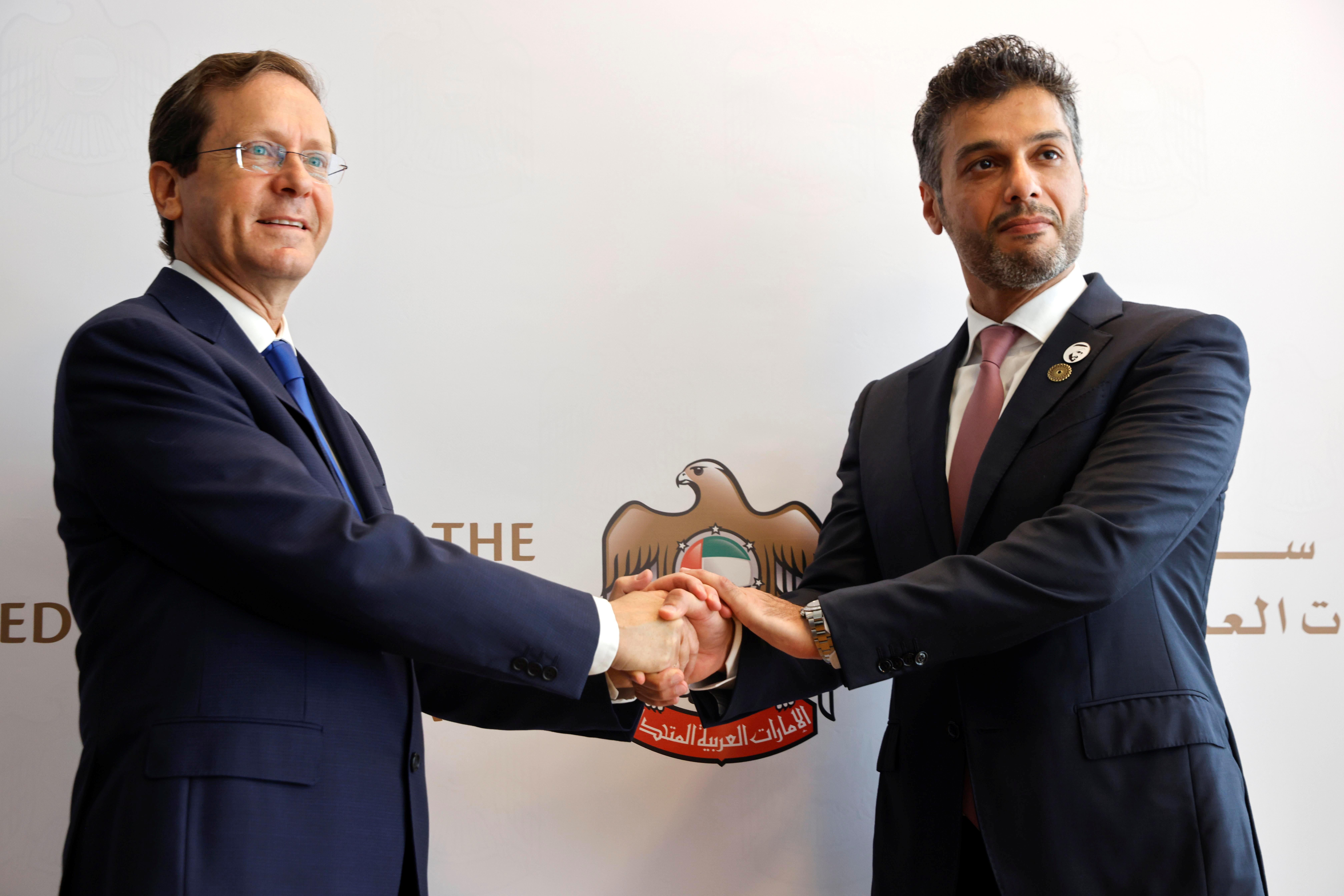 UAE Ambassador to Israel, Mohamed Al Khaja, and Israeli President Isaac Herzog shake hands during the opening ceremony of the Emirati embassy in Tel Aviv, Israel July 14, 2021. REUTERS/Amir Cohen