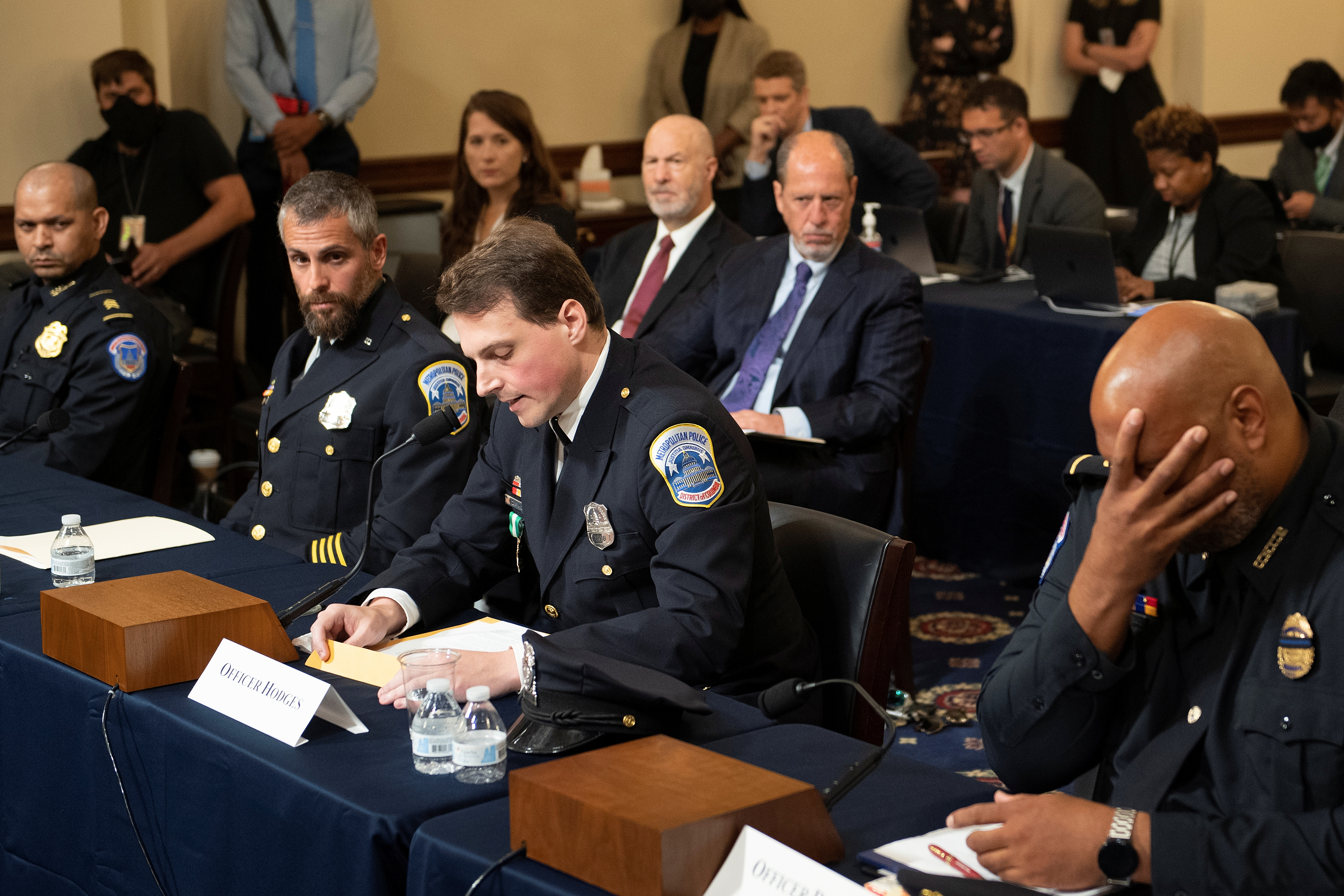 Aquilino Gonell, sergeant of the U.S. Capitol Police, Michael Fanone, officer for the Metropolitan Police Department, and Harry Dunn, private first class of the U.S. Capitol Police, listen while Daniel Hodges, officer for the Metropolitan Police Department, testifies during a hearing of the House select committee investigating the Jan. 6 attack on Capitol Hill in Washington, U.S., July 27, 2021.  Brendan Smialowski/Pool via REUTERS