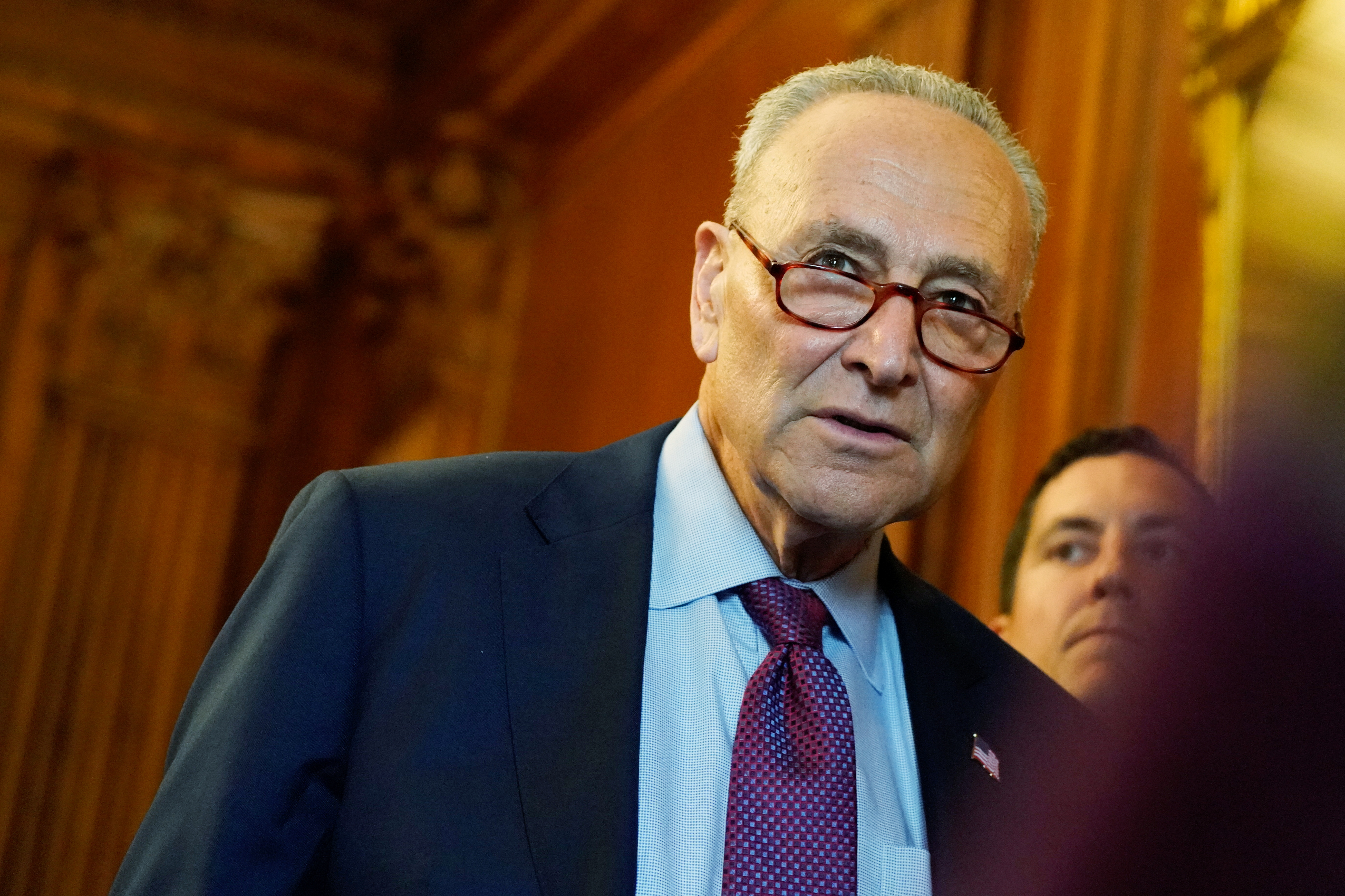 U.S. Senate Majority Leader Chuck Schumer attends a news conference with mothers helped by Child Tax Credit payments at the U.S. Capitol in Washington, U.S., July 20, 2021. REUTERS/Elizabeth Frantz