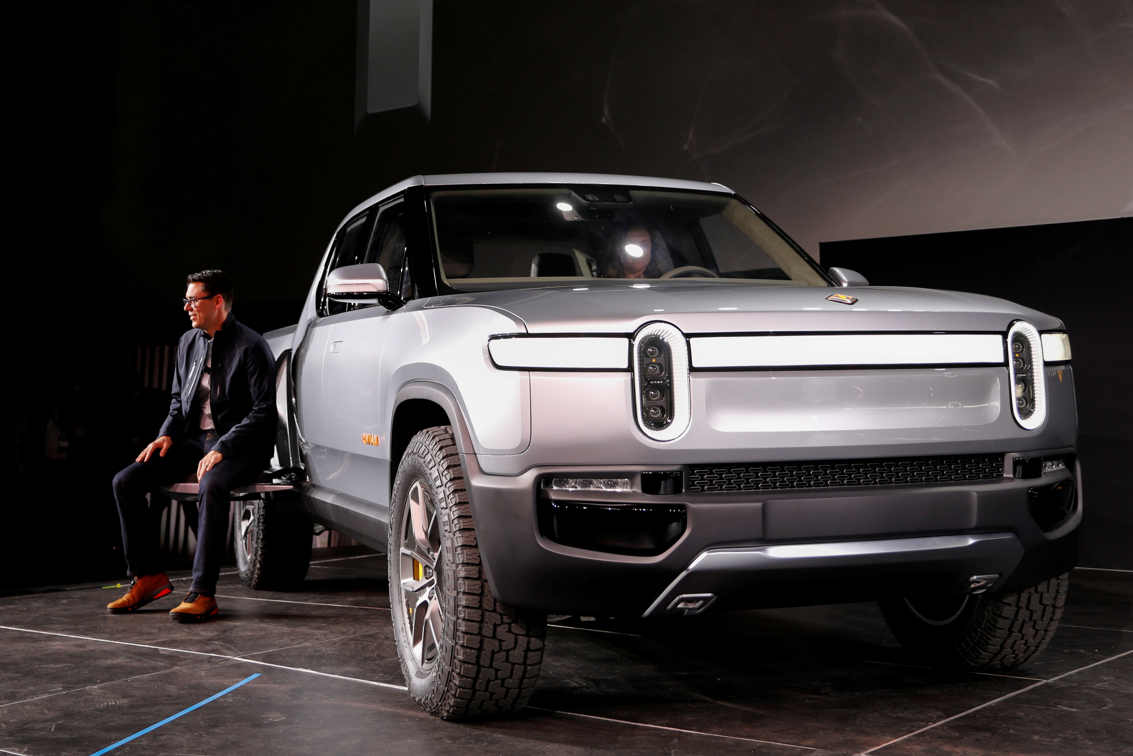 R.J. Scaringe, Rivian's CEO, introduces his company's R1T all-electric pickup truck at Los Angeles Auto Show in Los Angeles, California, U.S. November 27, 2018. REUTERS/Mike Blake