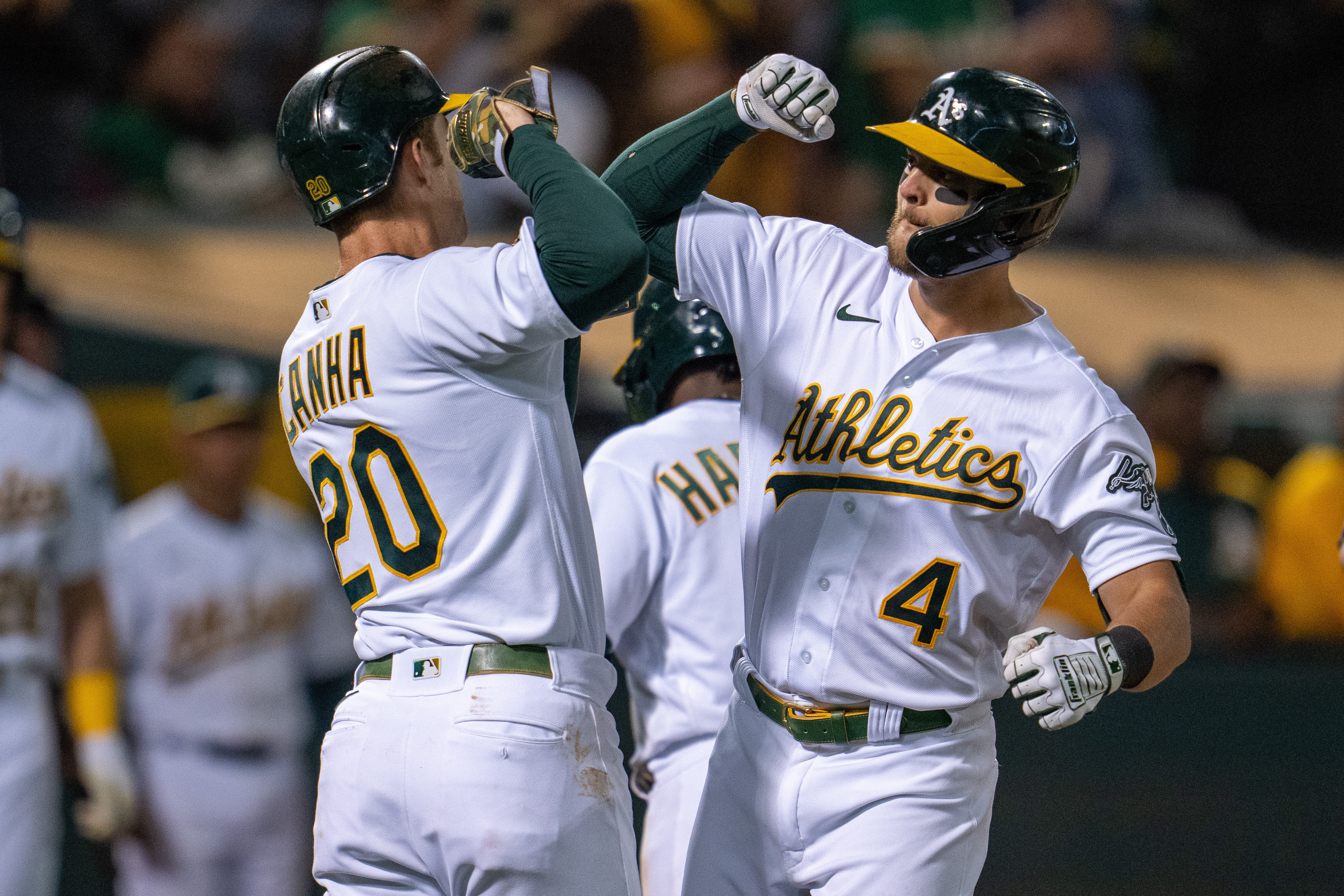 Sep 24, 2021; Oakland, California, USA;  Oakland Athletics designated hitter Mark Canha (20) and third baseman Chad Pinder (4) celebrate after a grand slam home run against the Houston Astros during the seventh inning at RingCentral Coliseum. Mandatory Credit: Neville E. Guard-USA TODAY Sports