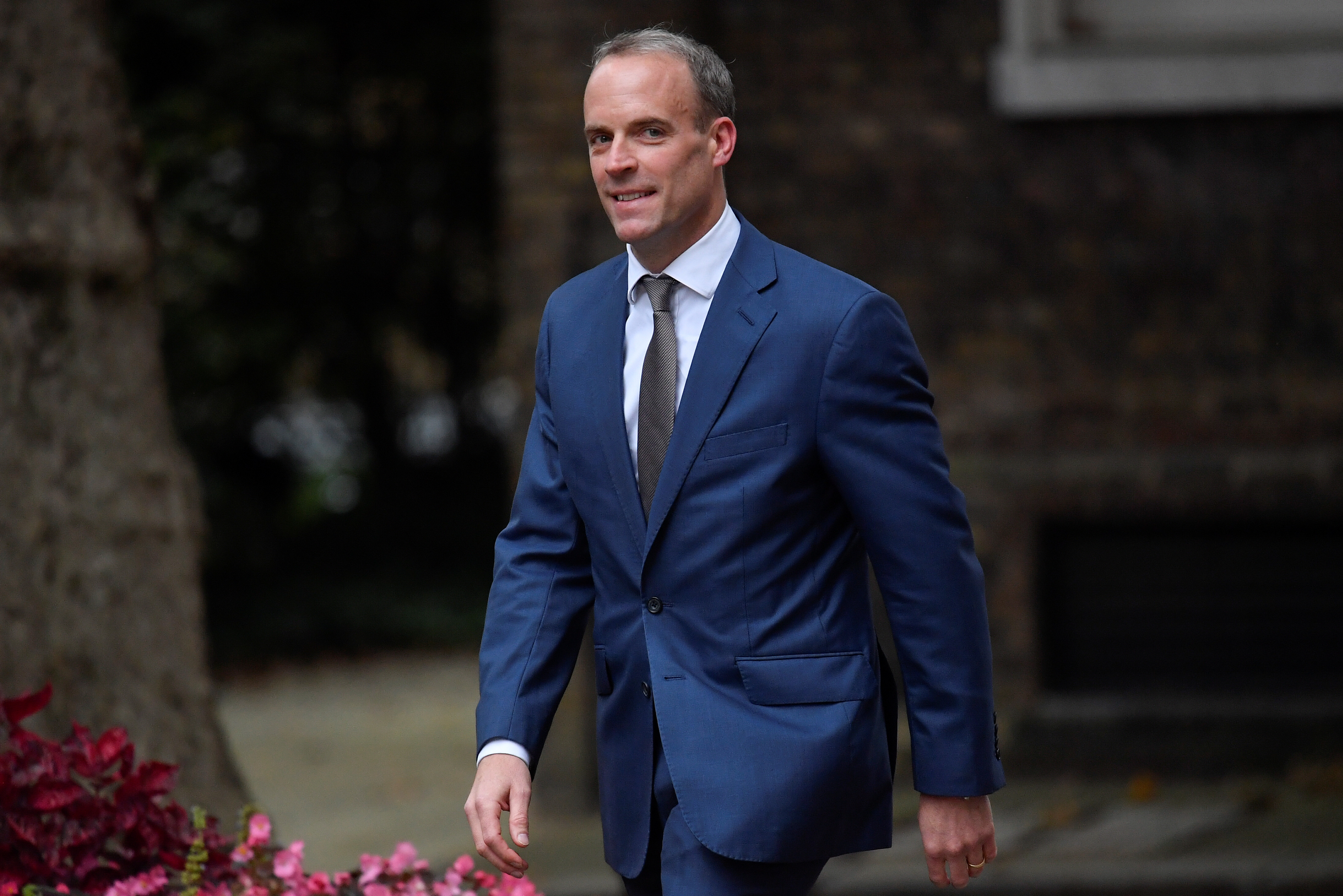 Dominic Raab, recently appointed as Justice Secretary, walks outside Downing Street in London, Britain, September 15, 2021. REUTERS/Toby Melville