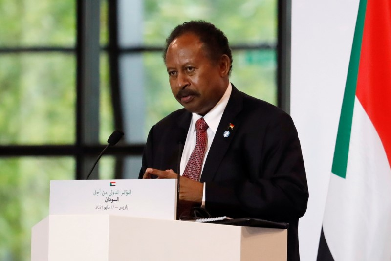 Sudan's Prime Minister Abdalla Hamdok attends a joint news conference with French President Emmanuel Macron and Sudan's Sovereign Council Chief General Abdel Fattah al-Burhan (not seen) during the International Conference in support of Sudan at the Temporary Grand Palais in Paris, France, May 17, 2021. REUTERS/Sarah Meyssonnier