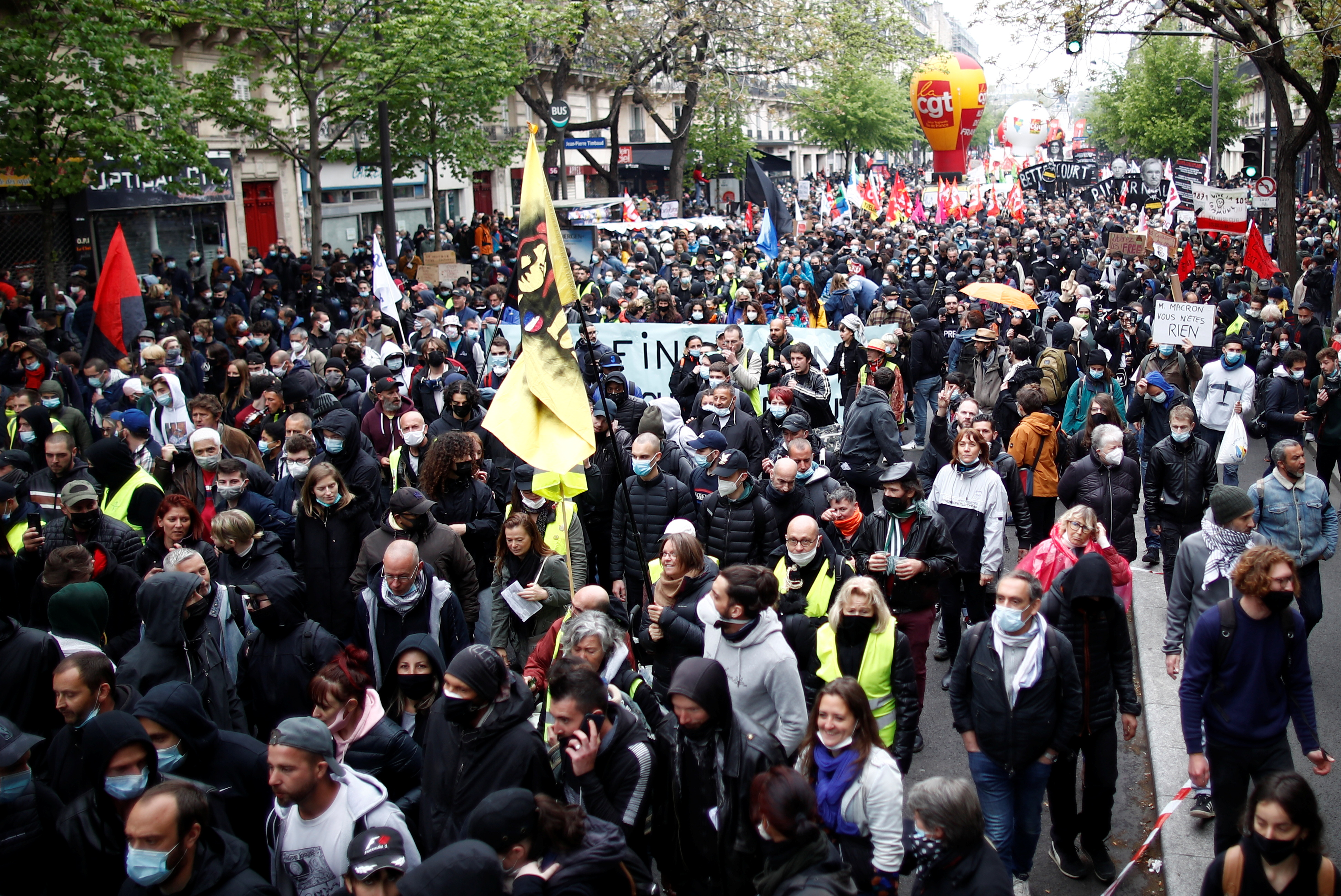 People attend the traditional May Day labour union march, amid the coronavirus disease (COVID-19) outbreak in Paris, France, May 1, 2021. REUTERS/Gonzalo Fuentes