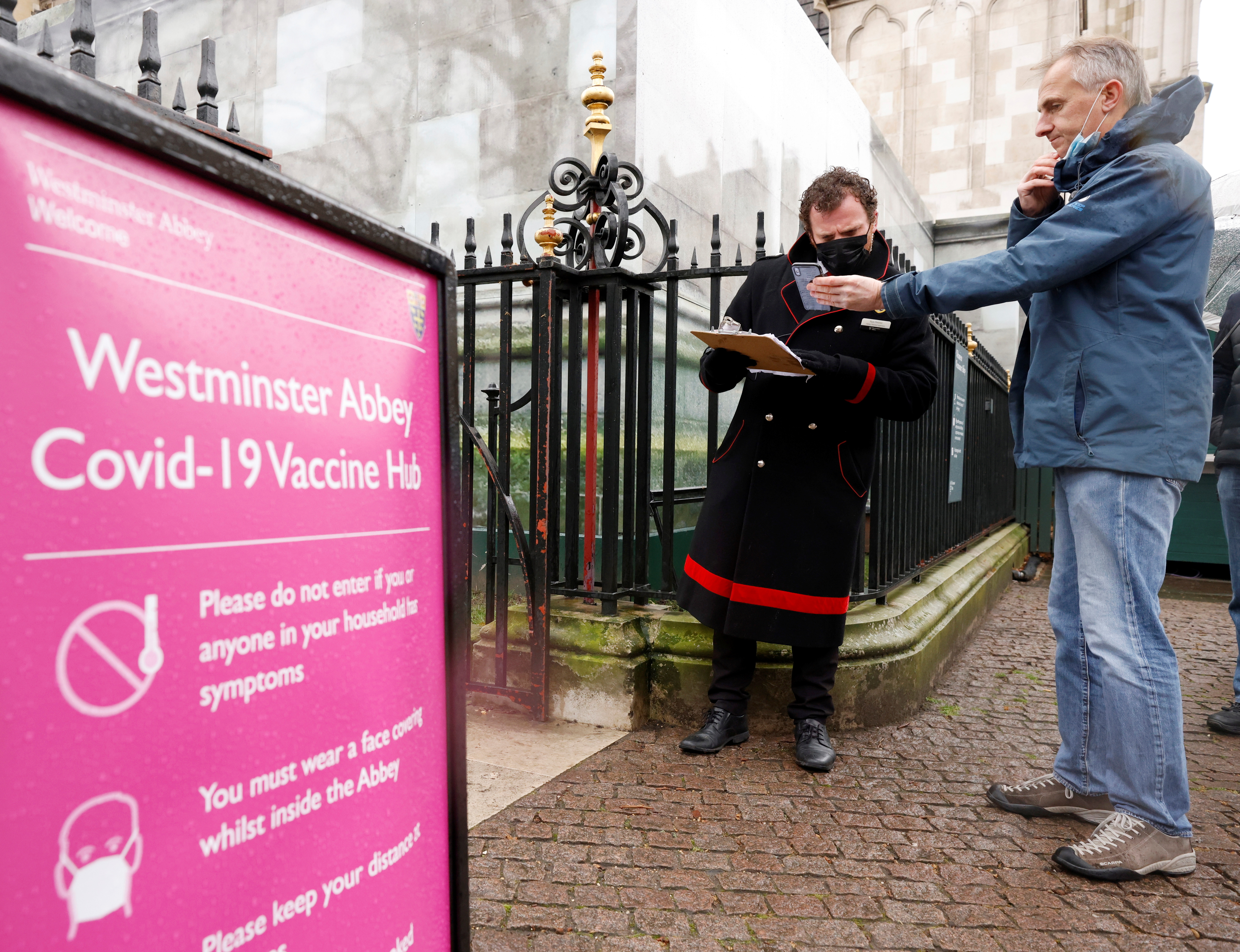 Patients are greeted by Abbey staff outside a vaccination centre at Westminster Abbey, amid the outbreak of coronavirus disease (COVID-19), in London, Britain, March 10, 2021. REUTERS/John Sibley