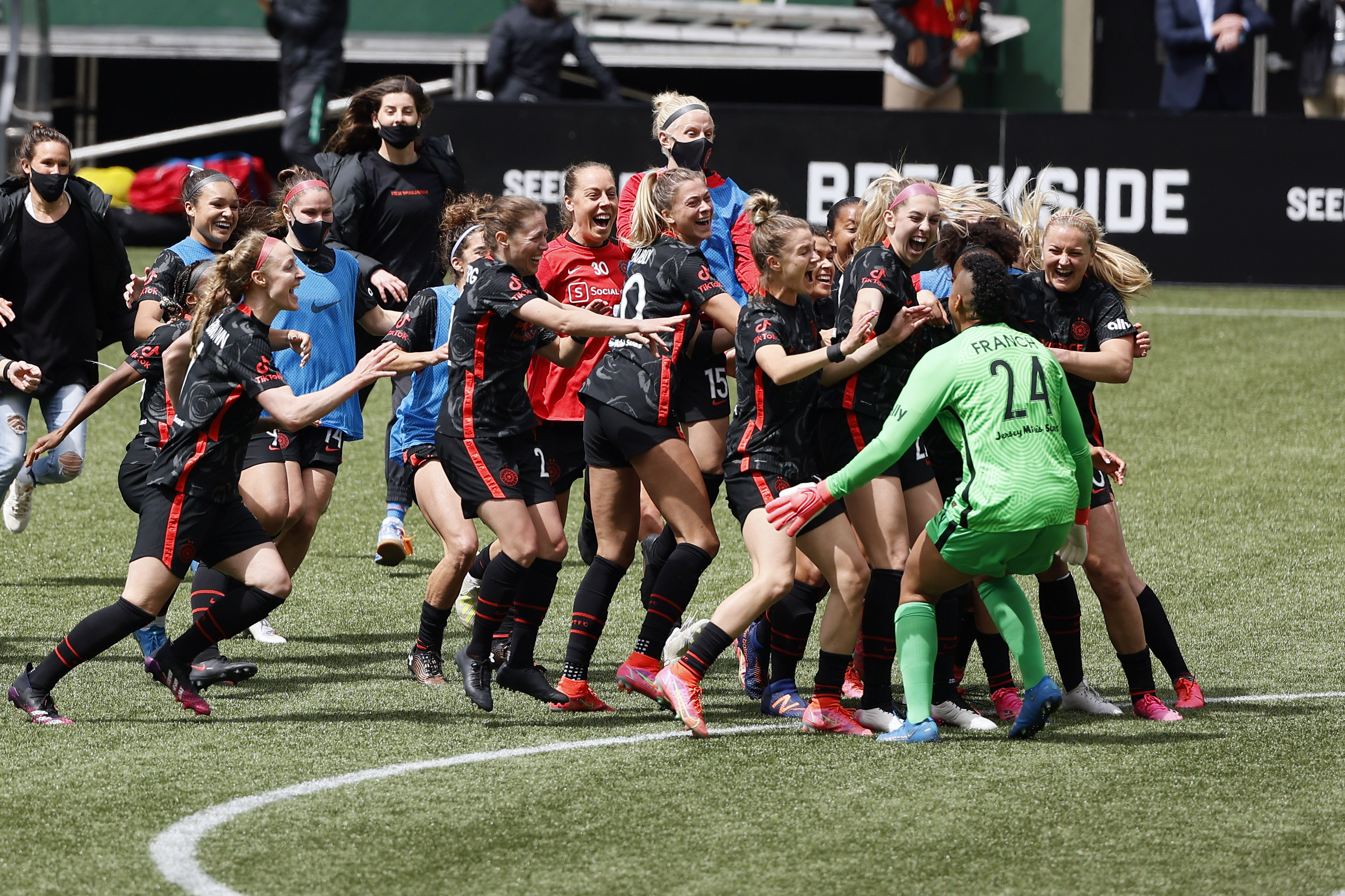 May 8, 2021; Portland, Oregon, USA; Portland Thorns goalkeeper Adrianna Franch (24) reacts with teammates after blocking a penalty shot by NJ/NY Gotham forward Nahomi Kawasumi (9) (not pictured) during the penalty shoot ou at Providence Park. Mandatory Credit: Soobum Im-USA TODAY Sports