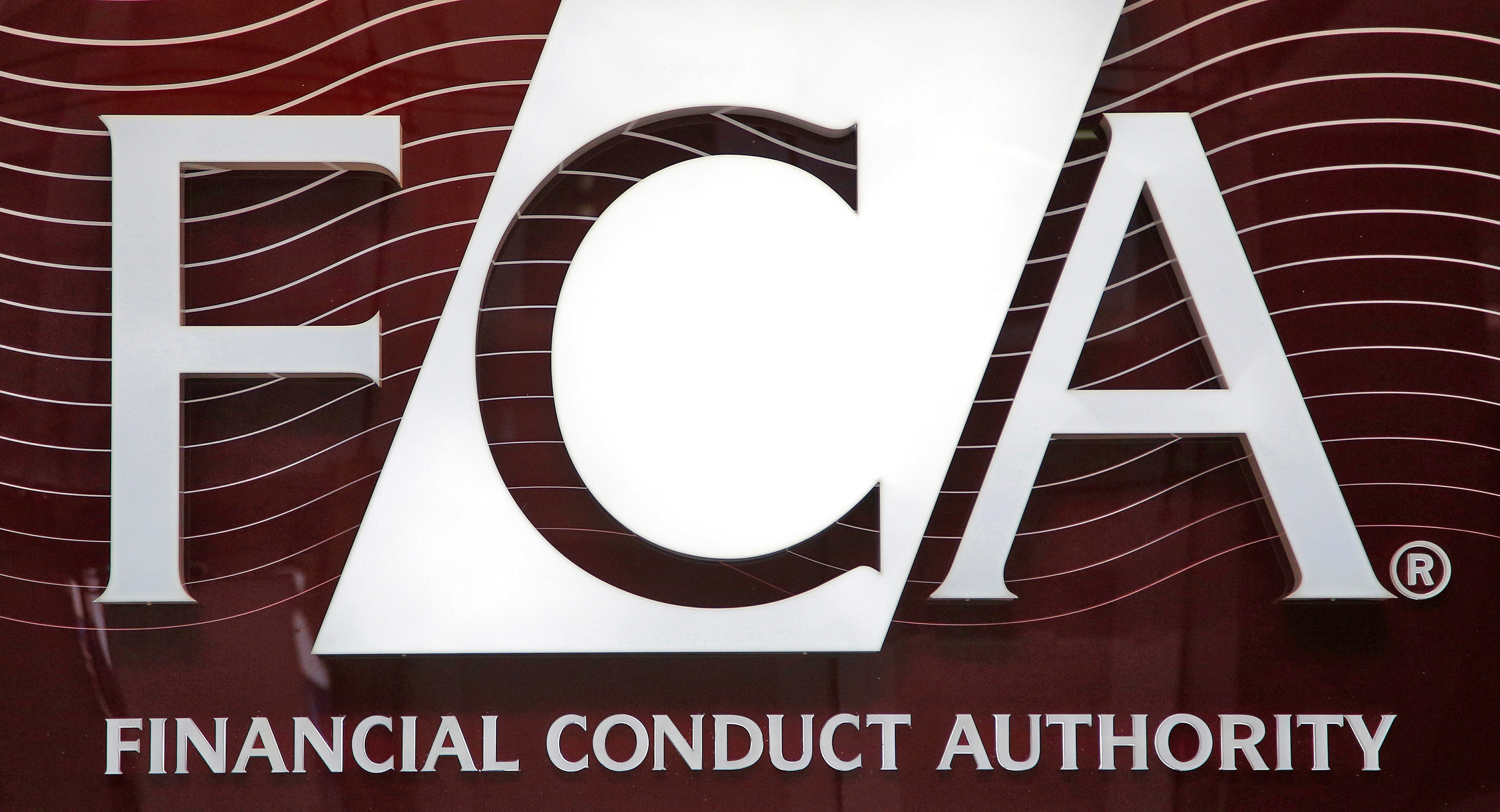 The logo of the new Financial Conduct Authority (FCA) is seen at the agency's headquarters in the Canary Wharf business district of London April 1, 2013. REUTERS/Chris Helgren/File Photo