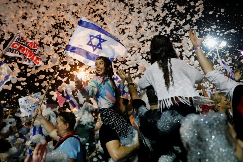 People celebrate after Israel's parliament voted in a new coalition government, ending Benjamin Netanyahu's 12-year hold on power, at Rabin Square in Tel Aviv, Israel June 13, 2021. REUTERS/Corinna Kern