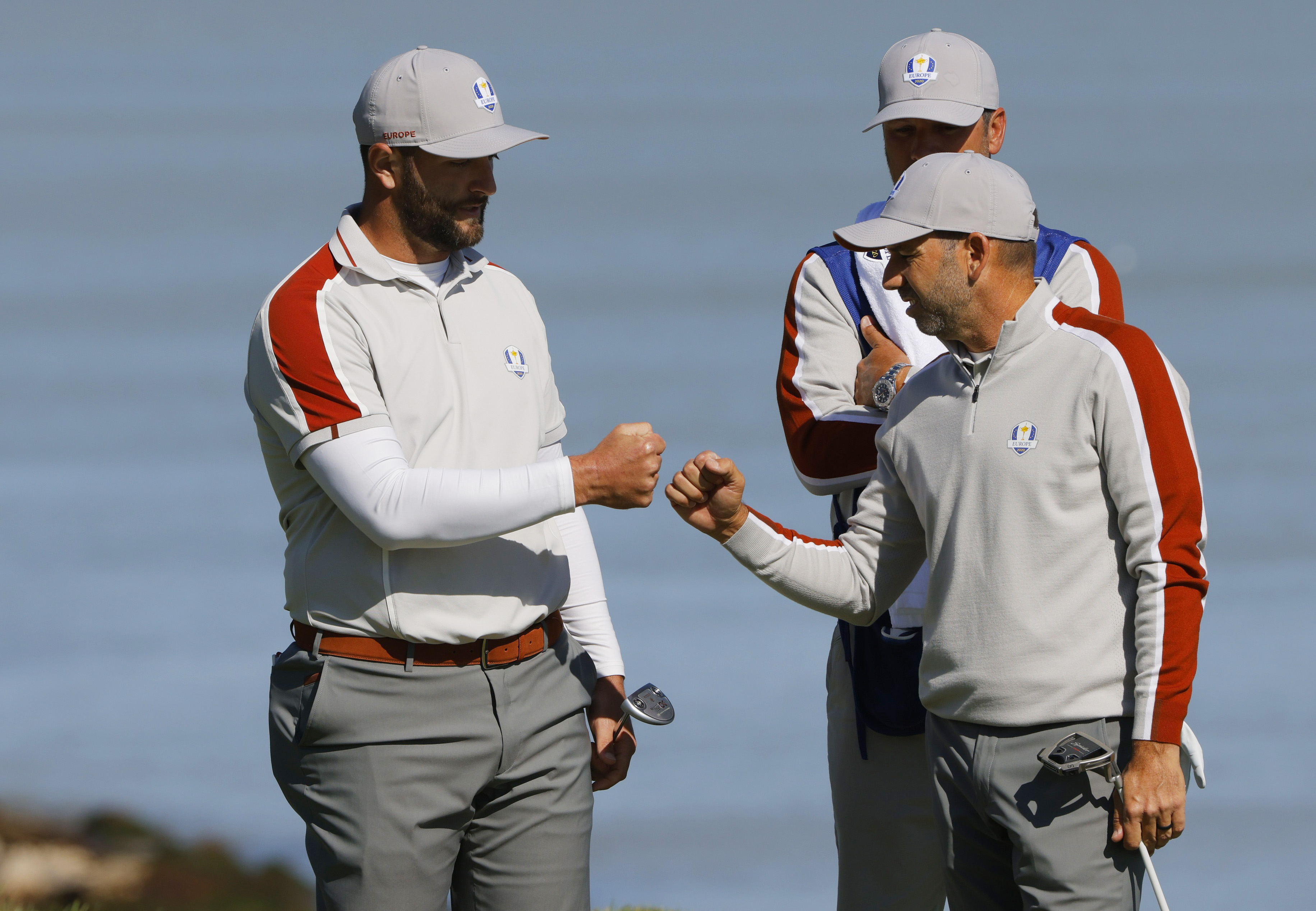 Golf - The 2020 Ryder Cup - Whistling Straits, Sheboygan, Wisconsin, U.S. - September 25, 2021 Team Europe's Jon Rahm and Team Europe's Sergio Garcia celebrate on the 17th green after winning the match during the Foursomes REUTERS/Brian Snyder