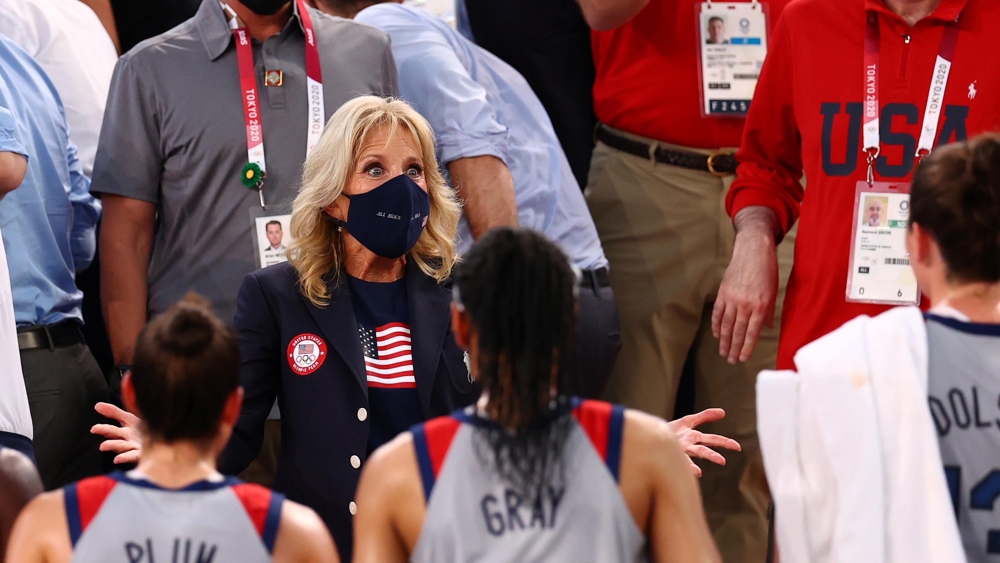 Tokyo 2020 Olympics - Basketball 3x3 - Women - Pool A - United States v France - Aomi Urban Sports Park, Tokyo, Japan - July 24, 2021. U.S. First Lady Jill Biden talks with players of the United States. REUTERS/Andrew Boyers