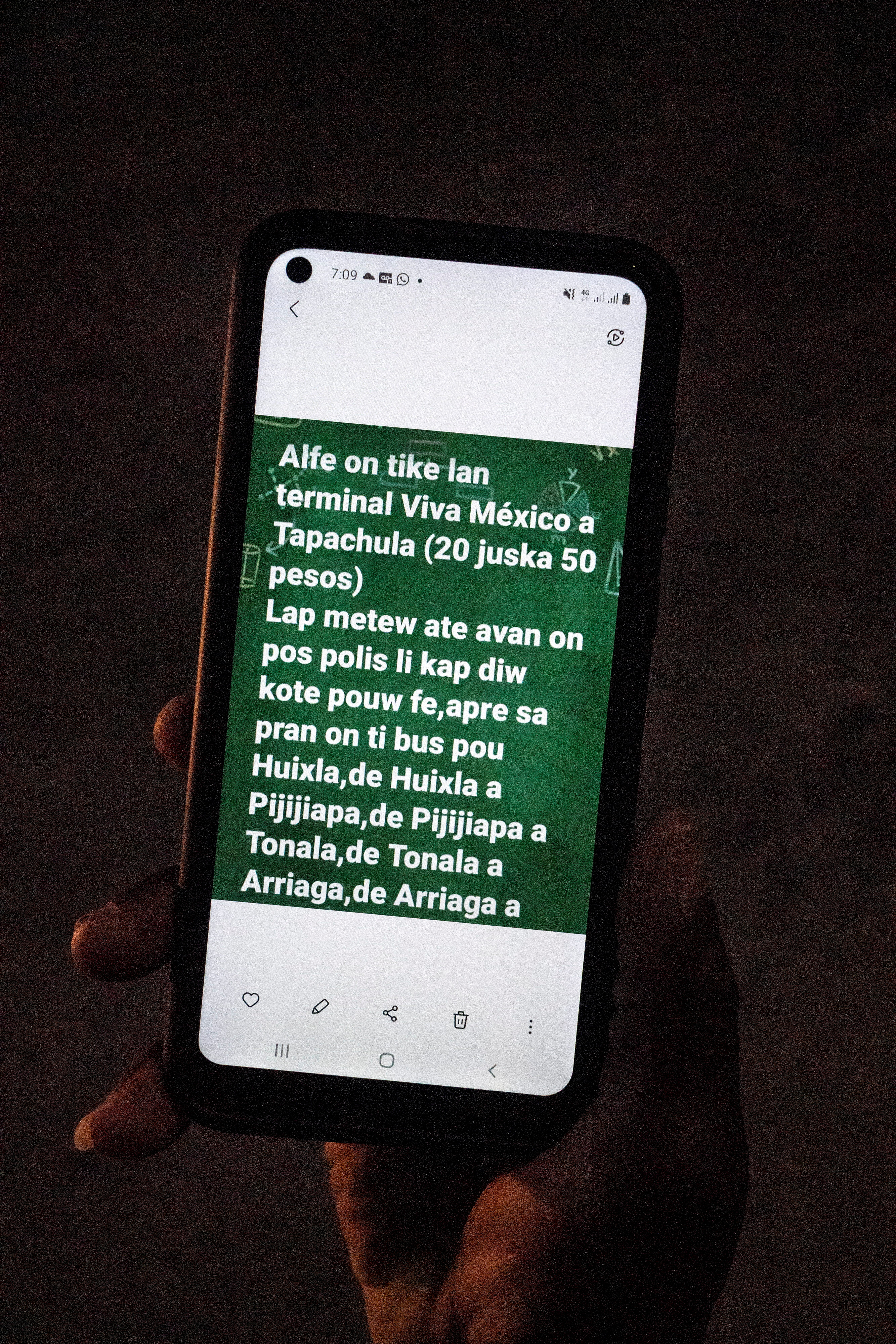A migrant seeking asylum in the U.S. shows his smartphone with instructions on how to get to the U.S., in Ciudad Acuna, Mexico, September 17, 2021. REUTERS/Go Nakamura