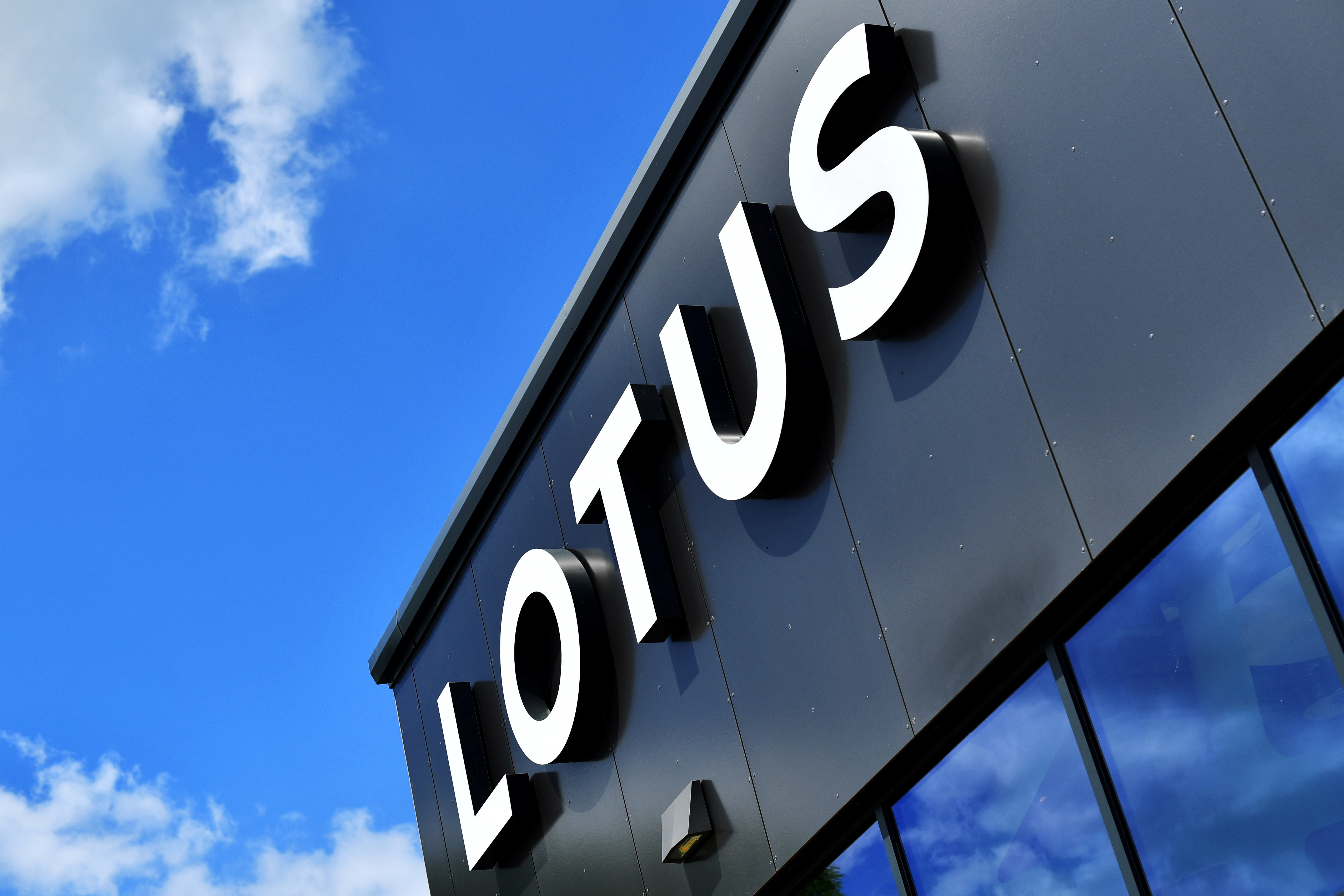 A Lotus sign is seen at the car plant headquarters in Hethel, Britain June 23, 2021. Picture taken June 23, 2021.    REUTERS/Dylan Martinez/File Photo