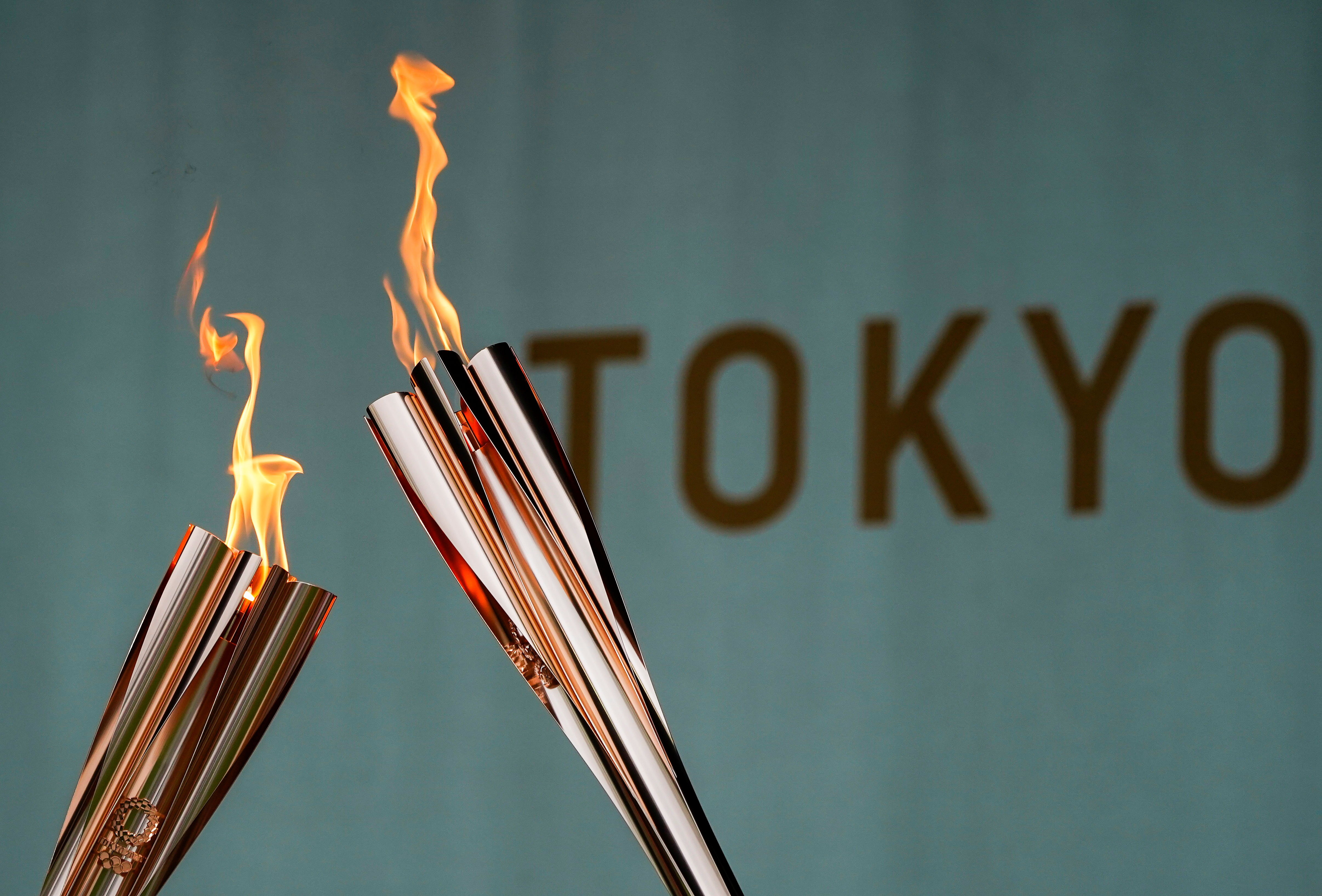 Torches are pictured during a lighting ceremony after the torch relay on a public road was cancelled due to the coronavirus disease (COVID-19) pandemic, at the Tokyo 2020 Olympic torch relay celebration in Tokyo, Japan, July 9, 2021. REUTERS/Naoki Ogura