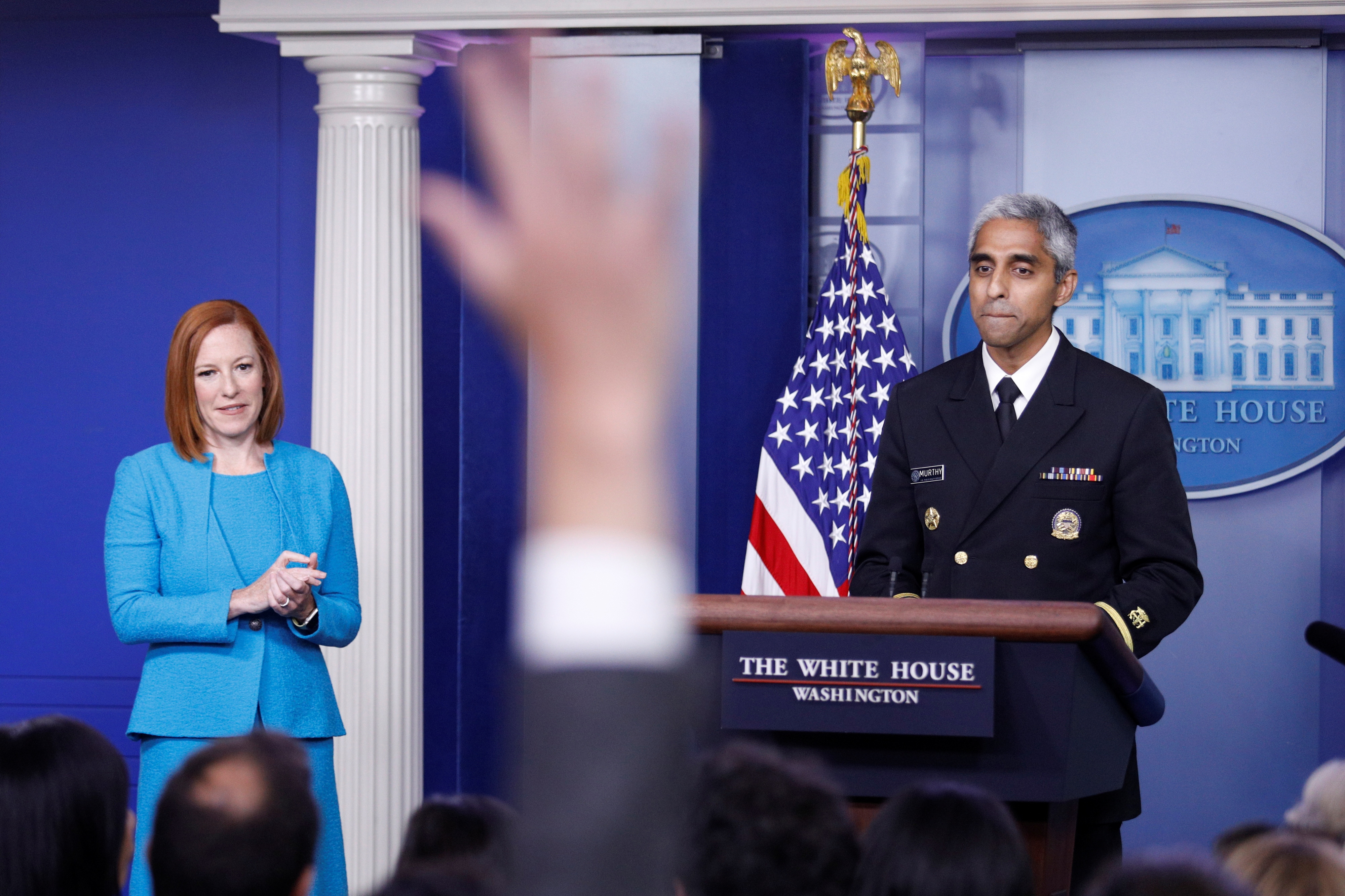 A journalist raises a hand to ask a question during United States Surgeon General Vivek Murthy's remarks at a news conference with White House Press Secretary Jen Psaki at the White House in Washington, U.S., July15, 2021. REUTERS/Tom Brenner