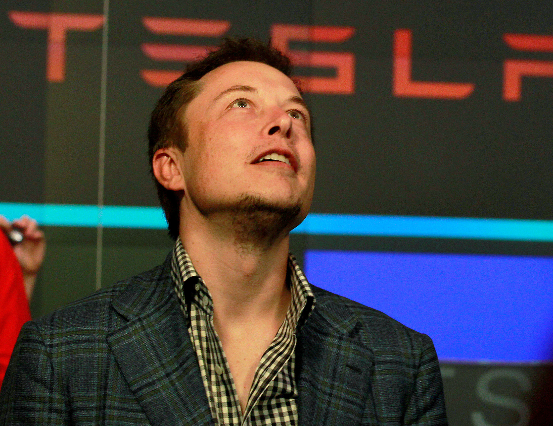 CEO of Tesla Motors Elon Musk reacts following the company's initial public offering at the NASDAQ market in New York June 29, 2010. REUTERS/Brendan McDermid/File Photo