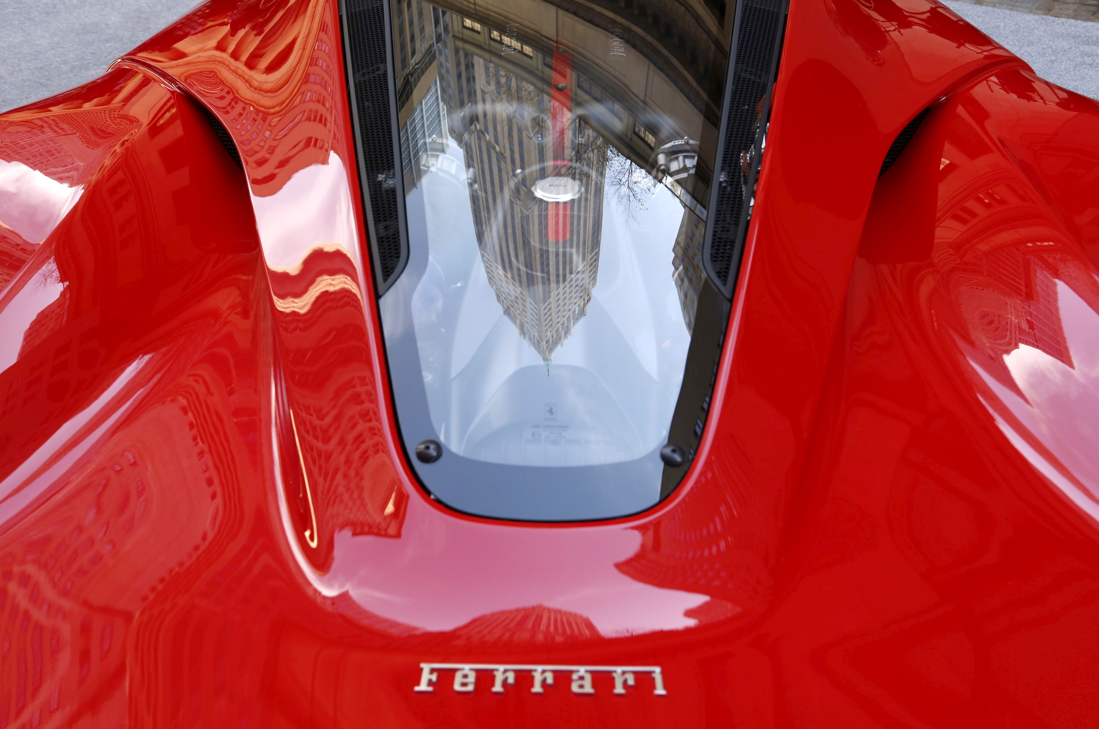 A Ferrari sports car sits outside the New York Stock Exchange October 21, 2015.  REUTERS/Lucas Jackson/File Photo