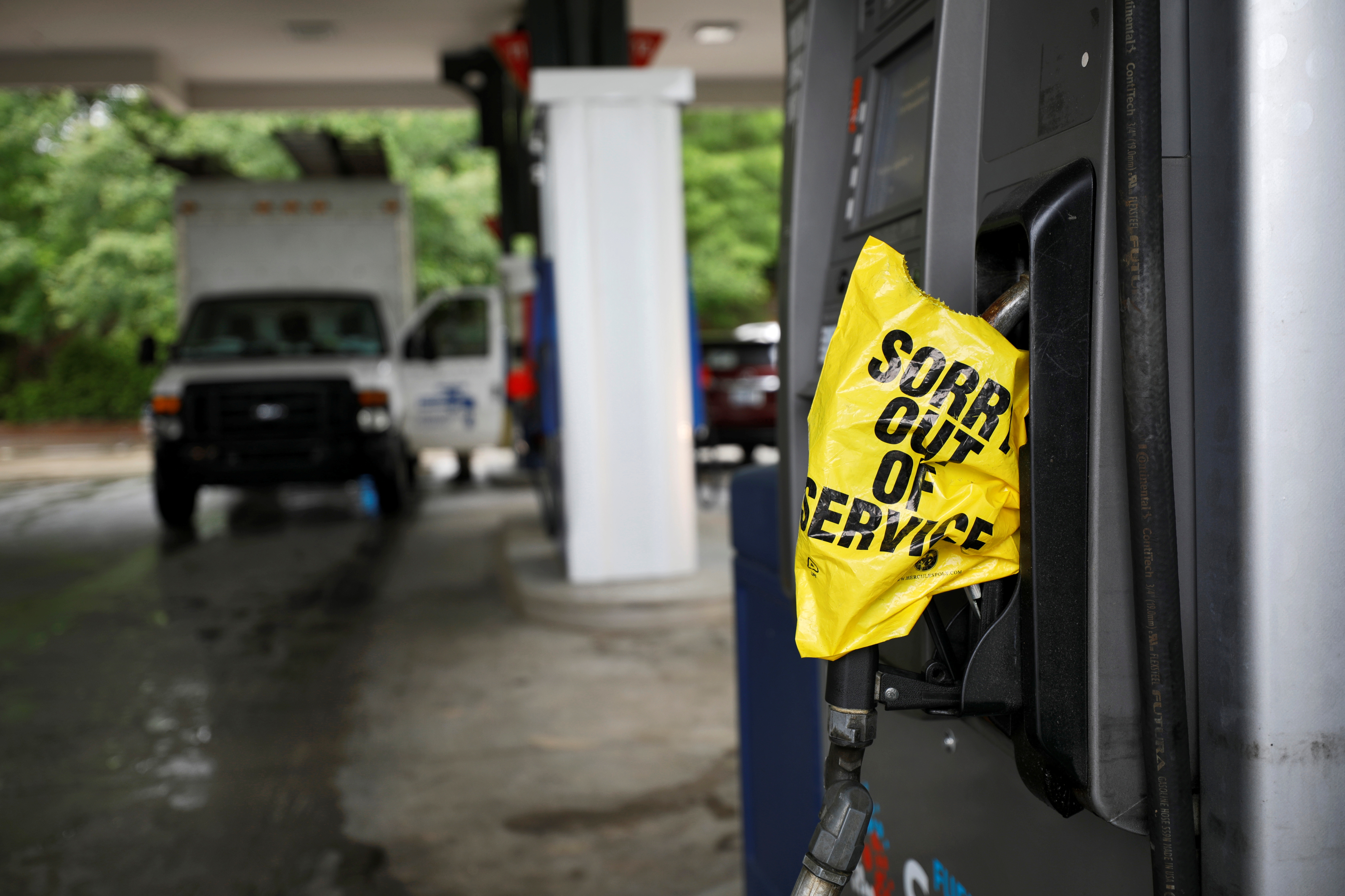 A bagged nozzle at a pump notifies motorists that it no longer has fuel after a cyberattack crippled the biggest fuel pipeline in the country, run by Colonial Pipeline, in Chapel Hill, North Carolina, U.S. May 12, 2021.  REUTERS/Jonathan Drake