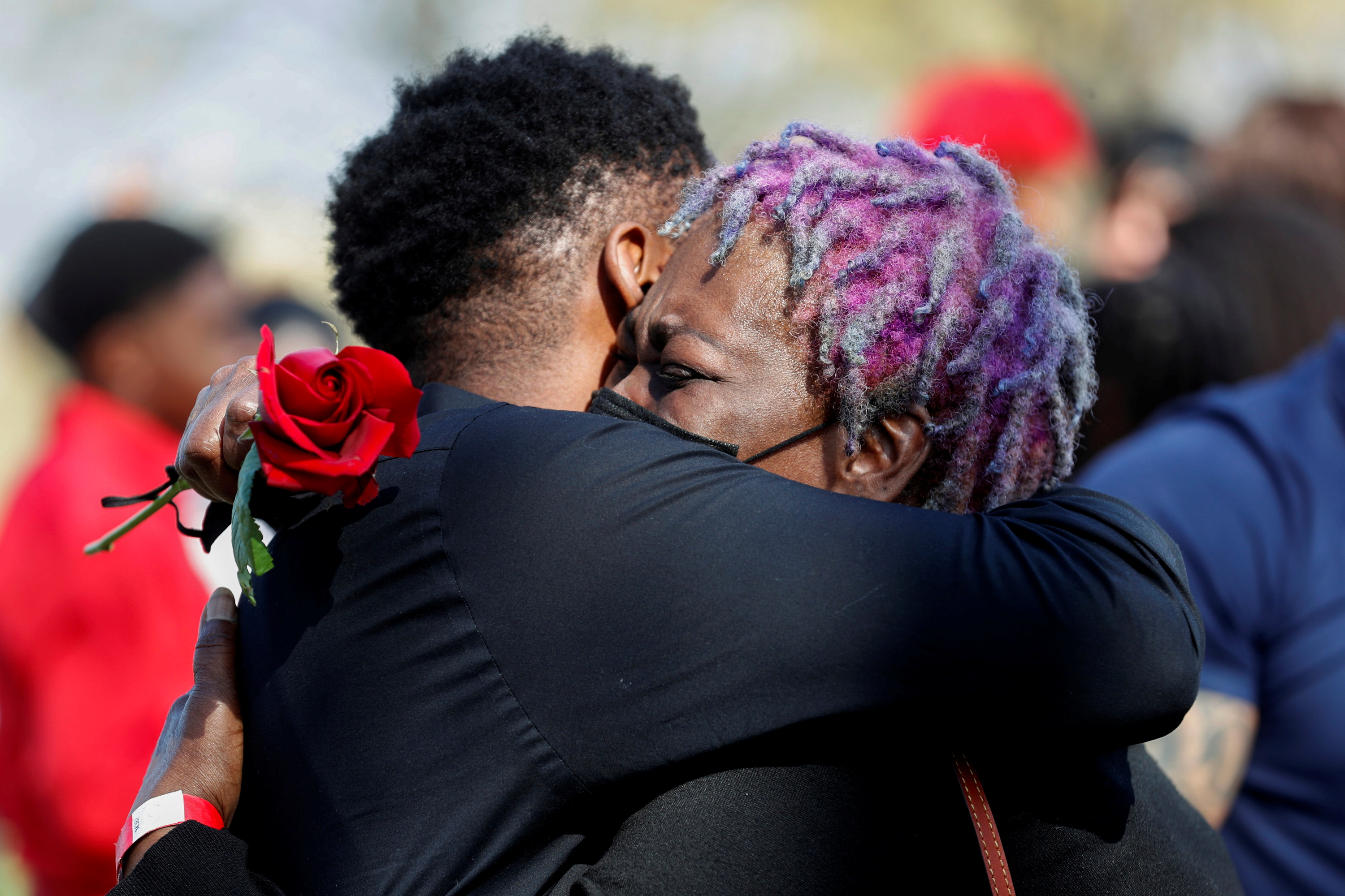 A family member hugs Angie Golson, grandmother of Daunte Wright, during a ceremony at the Lakewood Cemetery in Minneapolis, Minnesota, U.S., April 22, 2021. REUTERS/Octavio Jones
