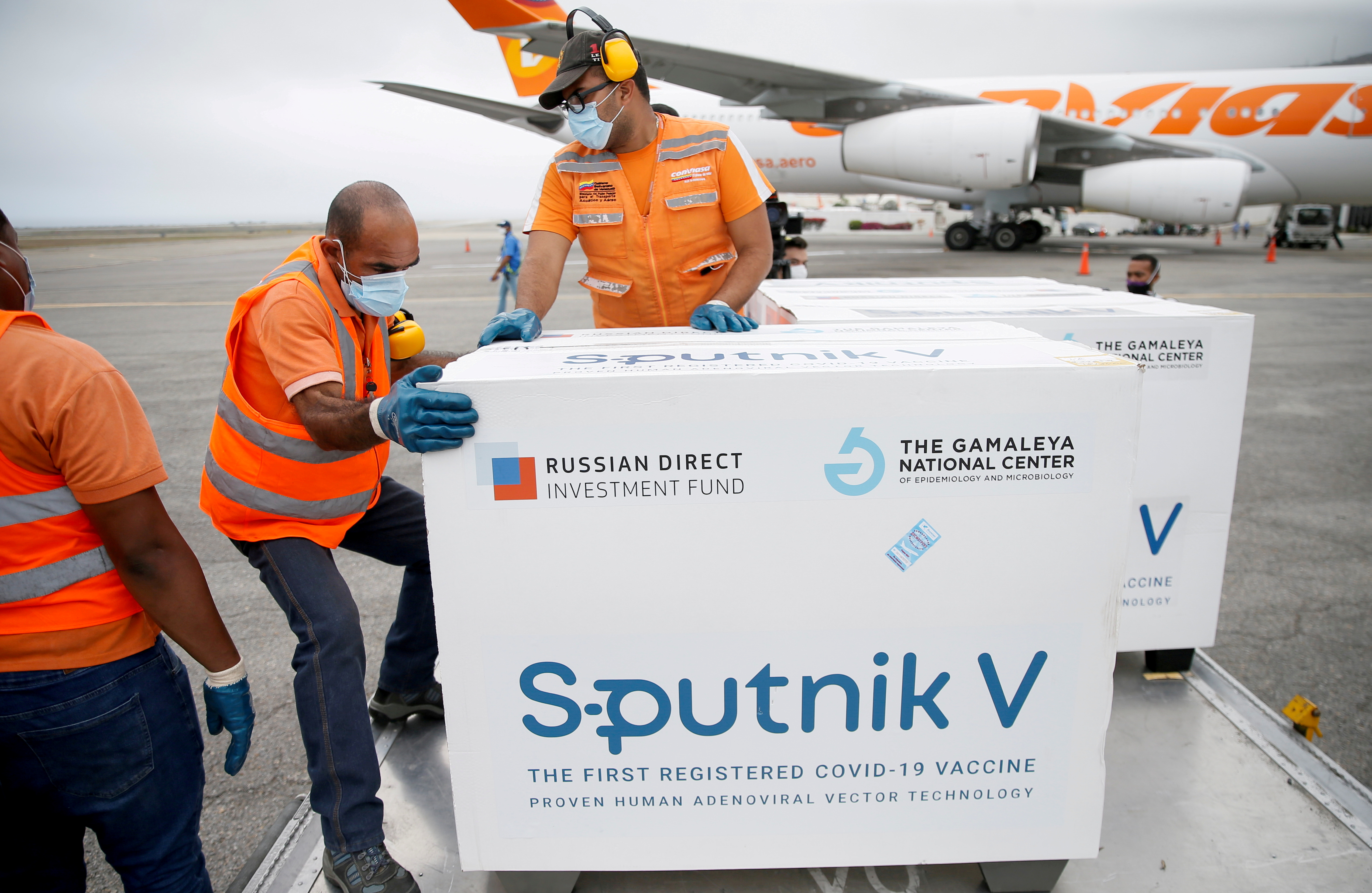 Workers take care of the shipment of Russia's Sputnik V vaccine against the coronavirus disease (COVID-19) at the airport, in Caracas, Venezuela March 29, 2021. REUTERS/Manaure Quintero/File Photo