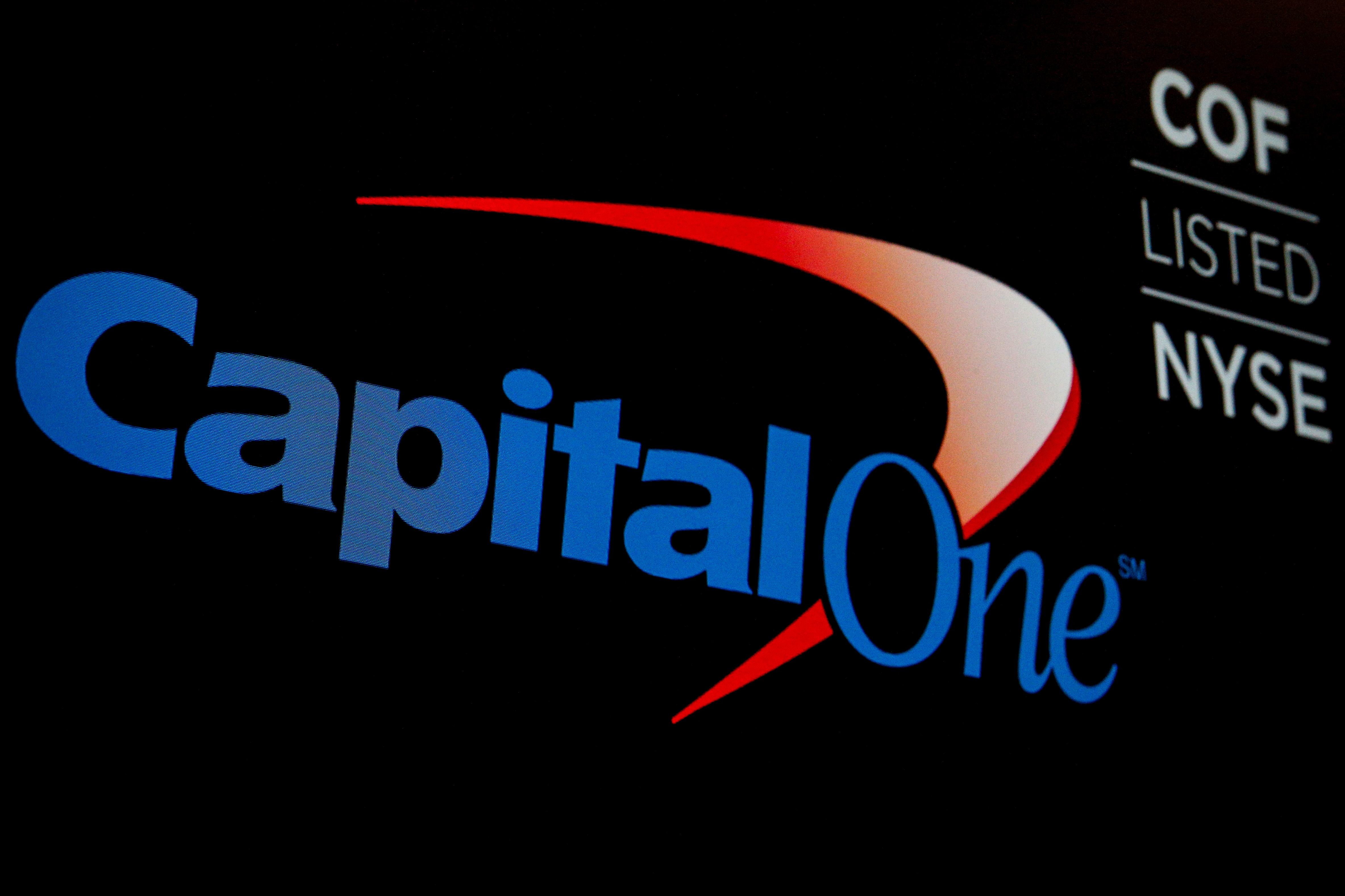 The logo and ticker for Capital One are displayed on a screen on the floor of the New York Stock Exchange (NYSE) in New York, U.S., May 21, 2018. REUTERS/Brendan McDermid/File Photo