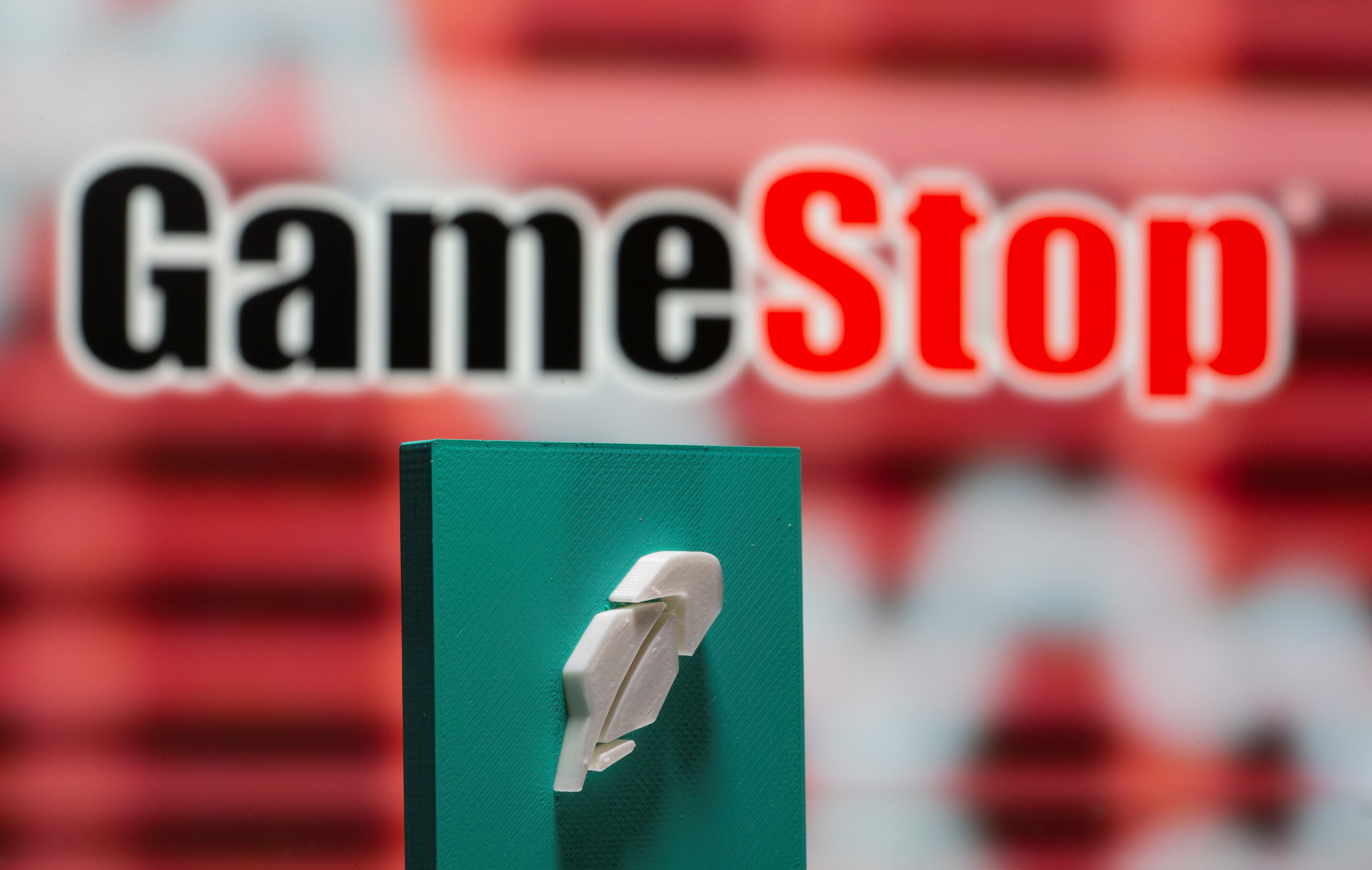 A 3d printed Robinhood logo is seen in front of displayed GameStop logo in this illustration taken February 8, 2021. REUTERS/Dado Ruvic/Illustration