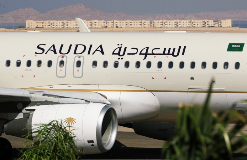 Saudi Arabian Airlines plane, is seen at the airport of the Red Sea resort of Sharm el-Sheikh, Egypt, August 9, 2021. Picture taken through a window. REUTERS/Mohamed Abd El Ghany