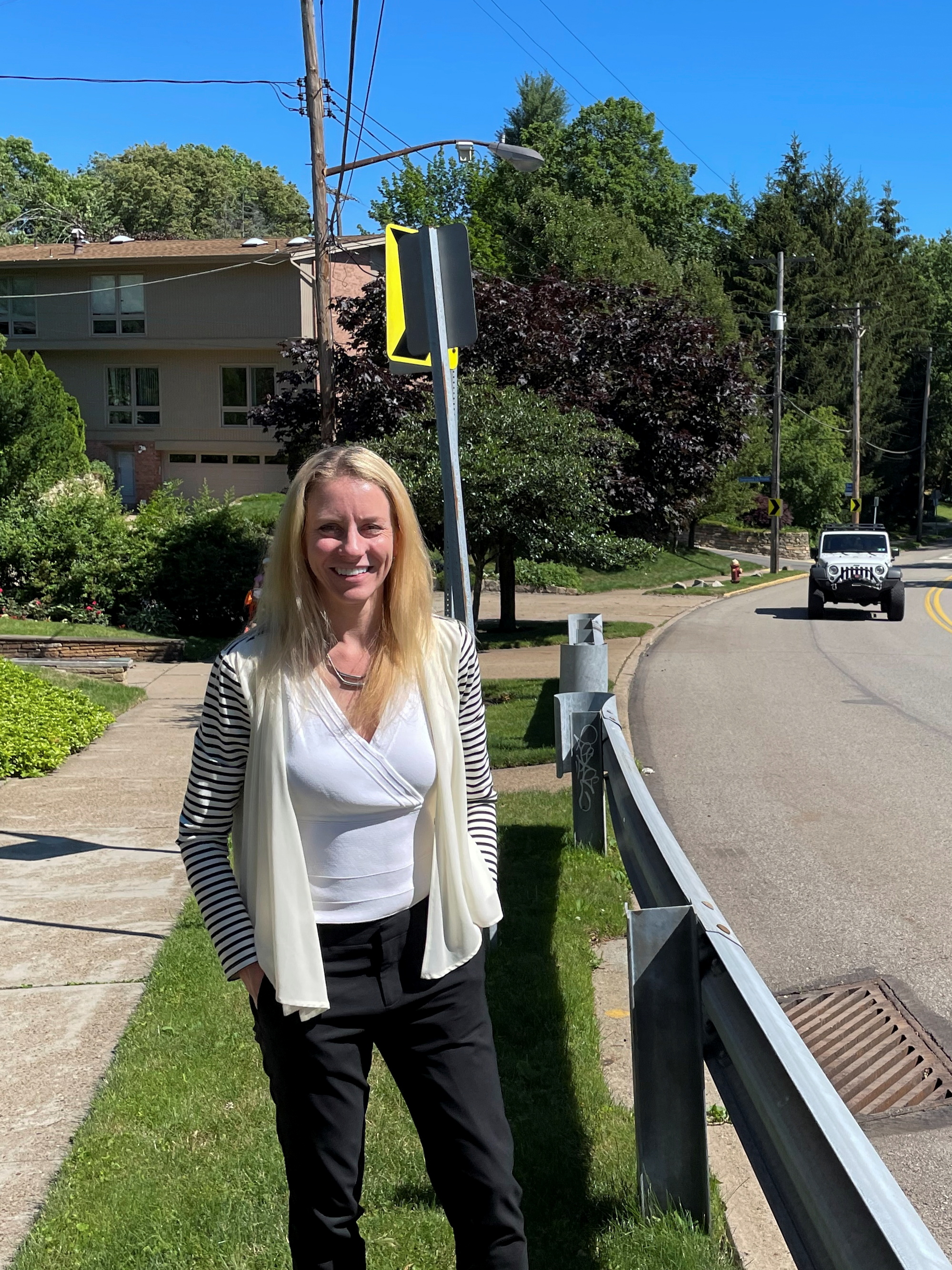 Pittsburgh City Council member Erika Strassburger stands near a protective guardrail on Shady Avenue in Pittsburgh, Pennsylvania, U.S. June 24, 2021. Picture taken June 24, 2021. REUTERS/Andy Sullivan