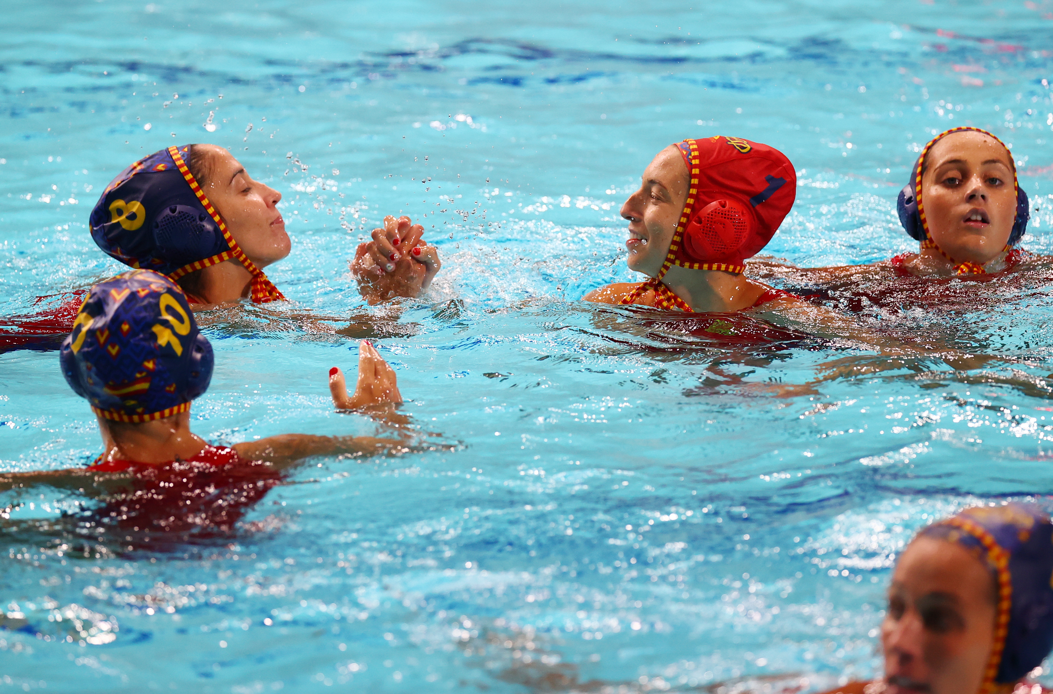 Tokyo 2020 Olympics - Water Polo - Women - Group A - South Africa v Spain - Tatsumi Water Polo Centre, Tokyo, Japan – July 24, 2021. Laura Ester Ramos of Spain greets Pili Pena of Spain. REUTERS/Kacper Pempel