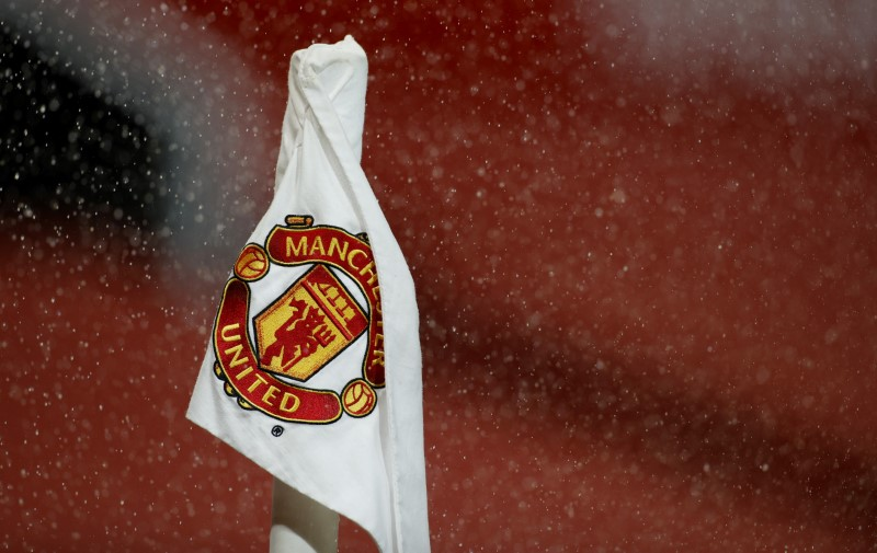 Soccer Football - Premier League - Manchester United v Manchester City - Old Trafford, Manchester, Britain - December 12, 2020 General view of the Manchester United crest on a corner flag before the match Pool via REUTERS/Phil Noble/Files