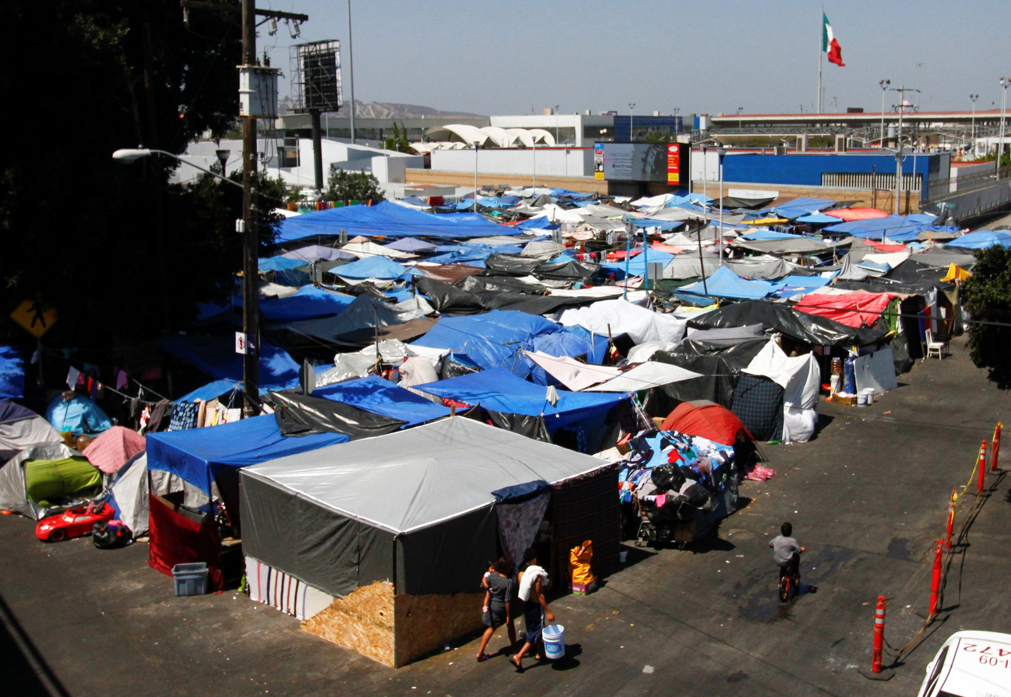 Tarps and tents are set up at a migrant camp near the El Chaparral border crossing with the U.S., in Tijuana, Mexico August 26, 2021. REUTERS/Jorge Duenes