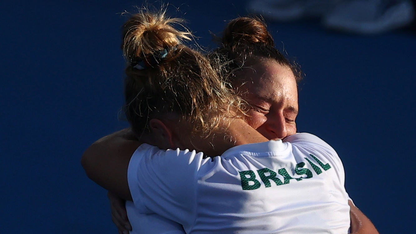Tokyo 2020 Olympics - Tennis - Women's Doubles - Bronze medal match - Ariake Tennis Park - Tokyo, Japan - July 31, 2021. Laura Pigossi of Brazil and Luisa Stefani of Brazil celebrate after winning their bronze medal match against Elena Vesnina of the Russian Olympic Committee and Veronika Kudermetova of the Russian Olympic Committee.REUTERS/Yara Nardi