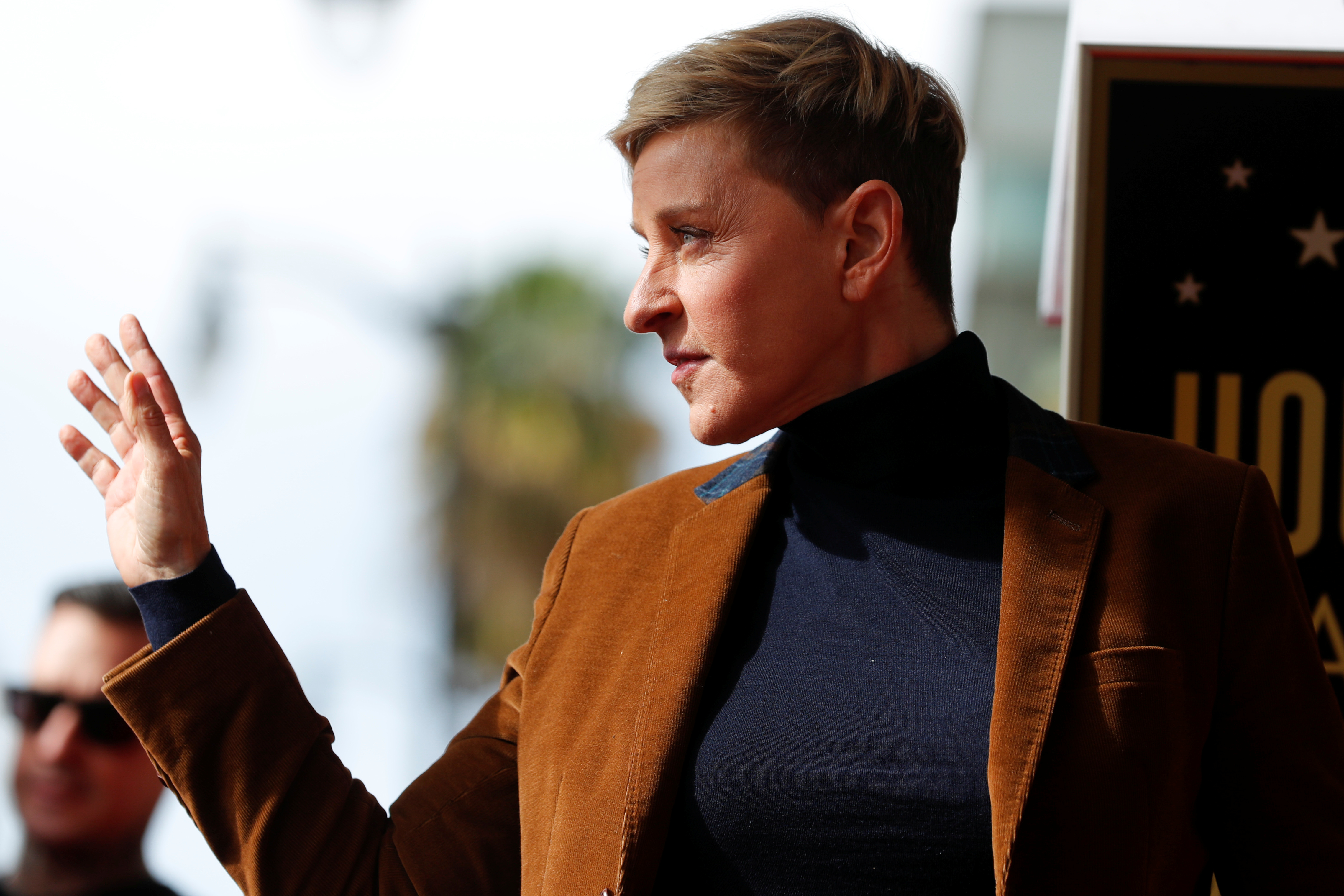 Comedian and talkshow host Ellen DeGeneres waves to fans as she attends a ceremony for singer Pink at the Hollywood Walk of Fame in Los Angeles, California, U.S., February 5, 2019.    REUTERS/Mike Blake