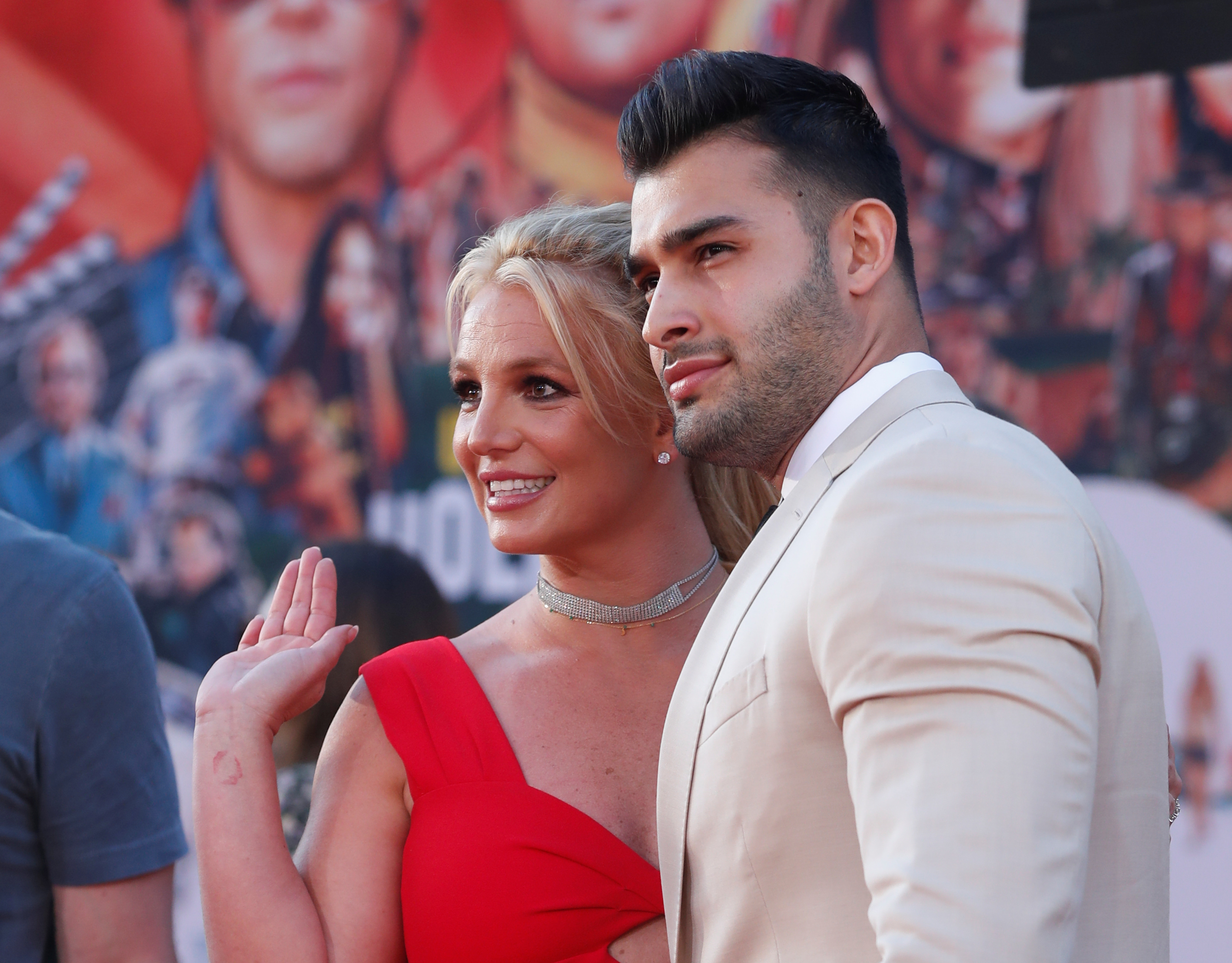 Britney Spears and Sam Asghari pose at the premiere of