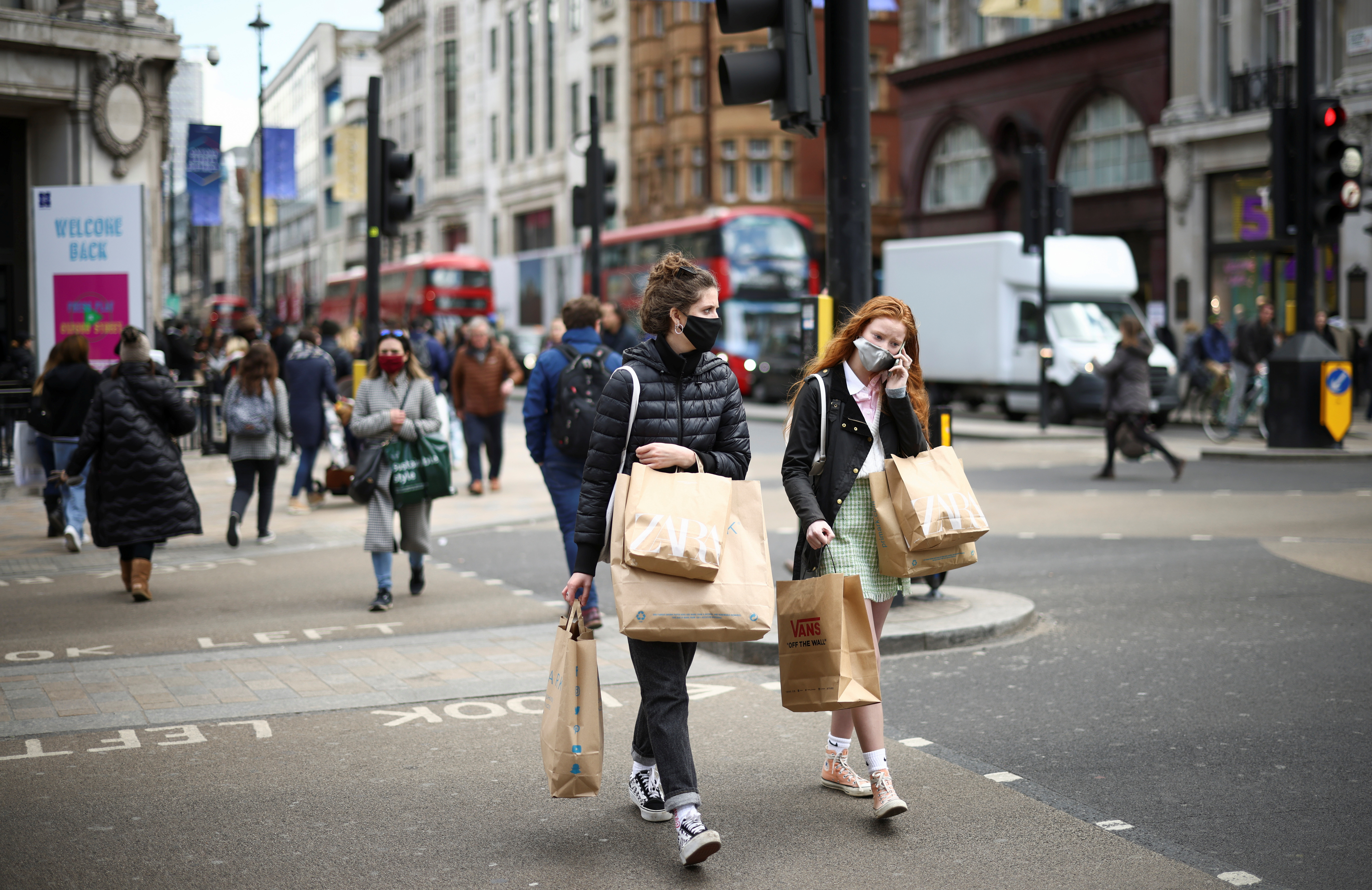 People walk at Oxford Street, as the coronavirus disease (COVID-19) restrictions ease, in London, Britain April 12, 2021. REUTERS/Henry Nicholls/File photo
