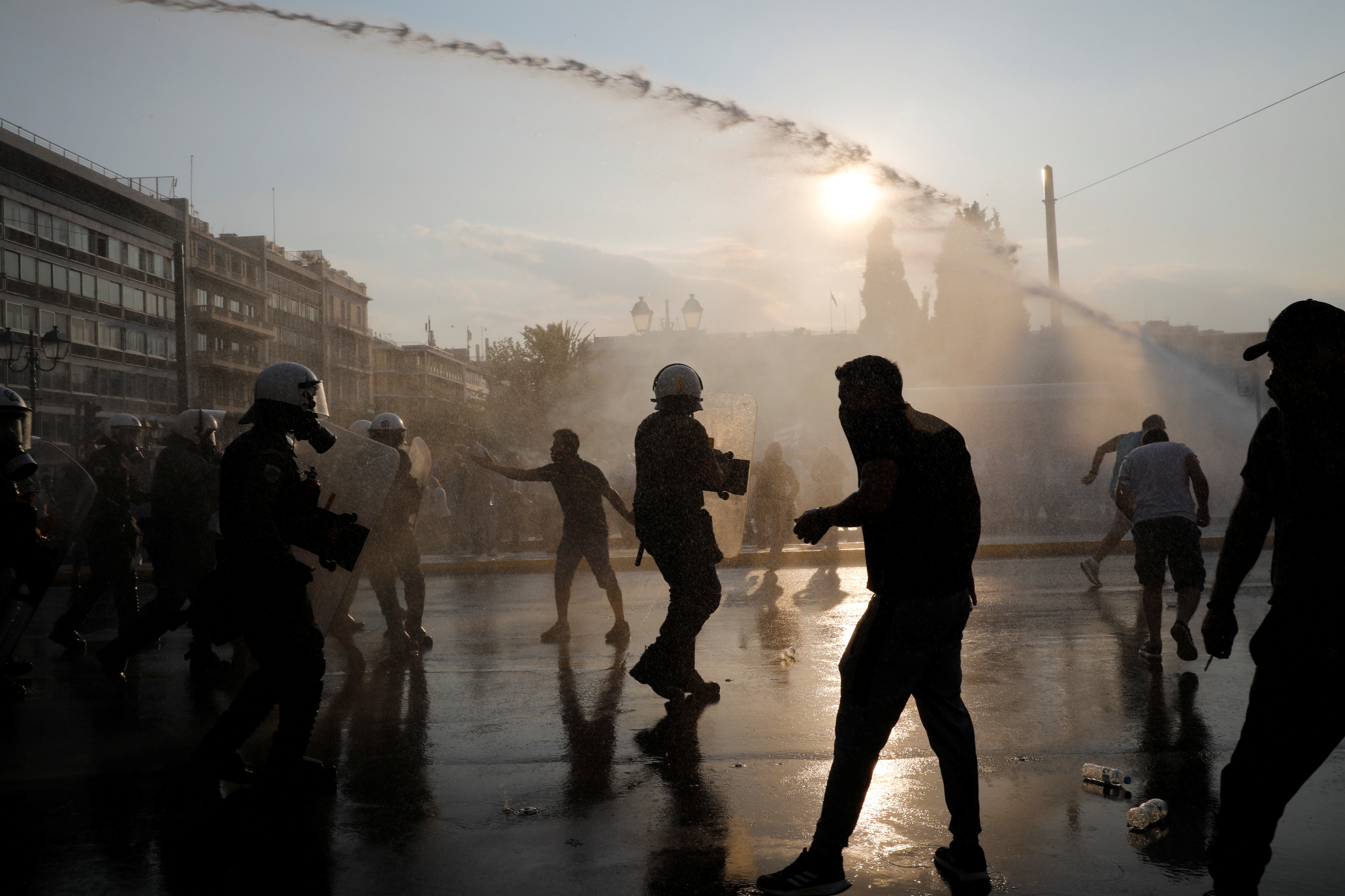 Police use water cannon against demonstrators during a protest againstcoronavirusdisease (COVID-19) vaccinations outside the parliament building, in Athens, Greece, July 21, 2021. REUTERS/Costas Baltas
