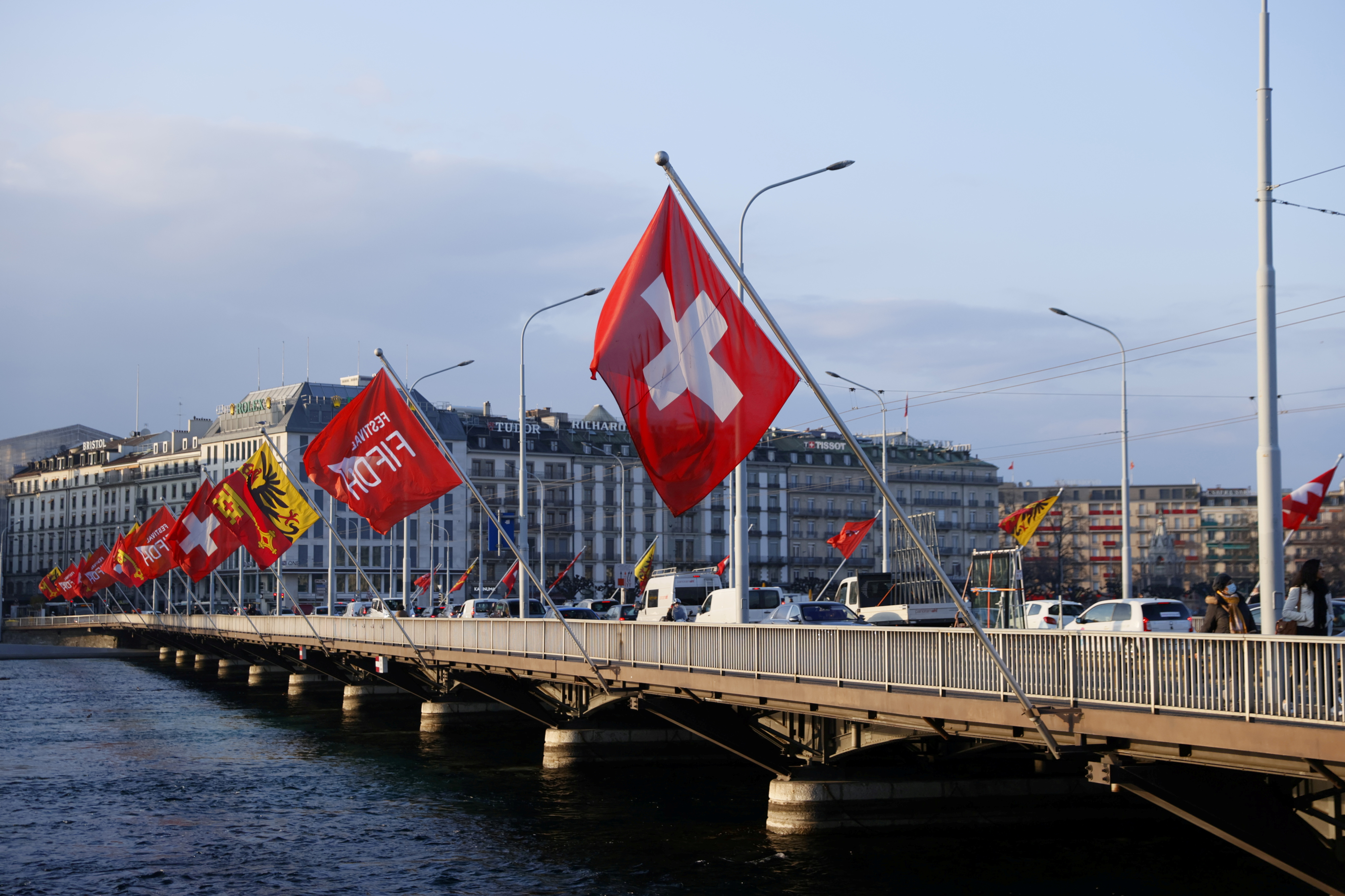 A Swiss flag is pictured on the Mont-Blanc bridge, amid the coronavirus disease (COVID-19) pandemic, in Geneva, Switzerland, March 8, 2021. REUTERS/Denis Balibouse