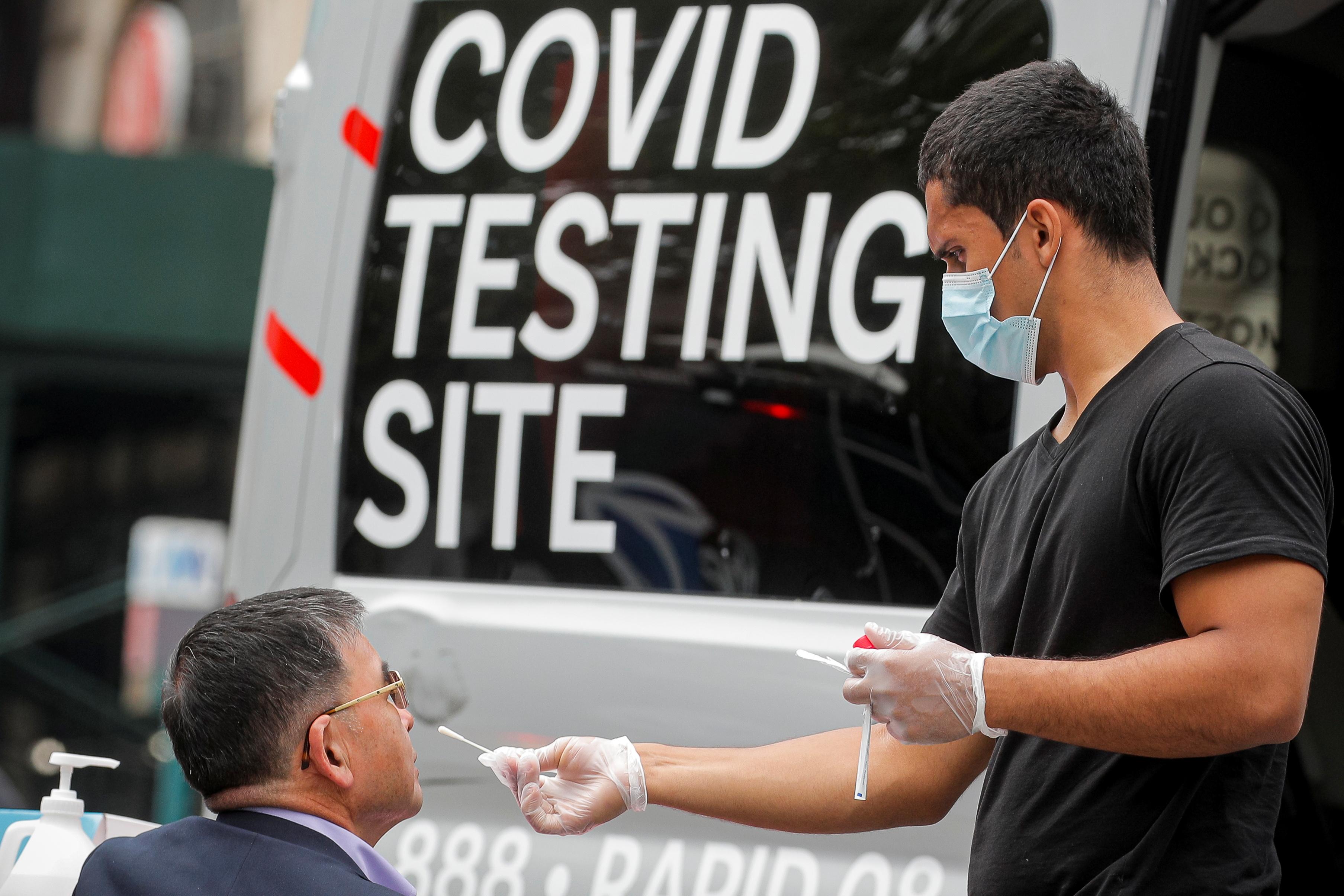 A man receives a coronavirus disease (COVID-19) test at a mobile testing van in Brooklyn, New York, U.S., June 2, 2021. REUTERS/Brendan McDermid