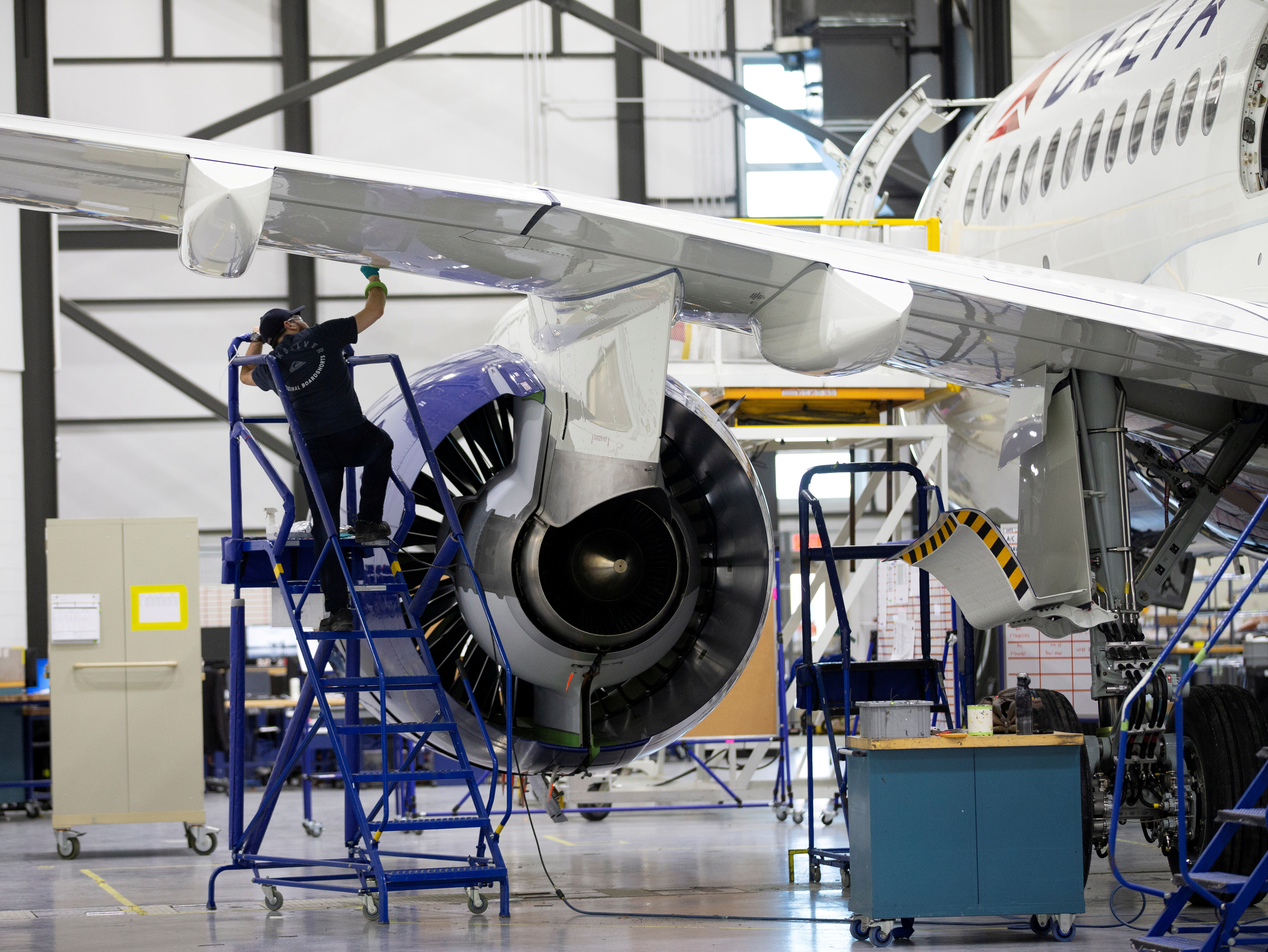 An employee works on an Airbus A220-300 at the Airbus facility in Mirabel, Quebec, Canada February 20, 2020.  REUTERS/Christinne Muschi