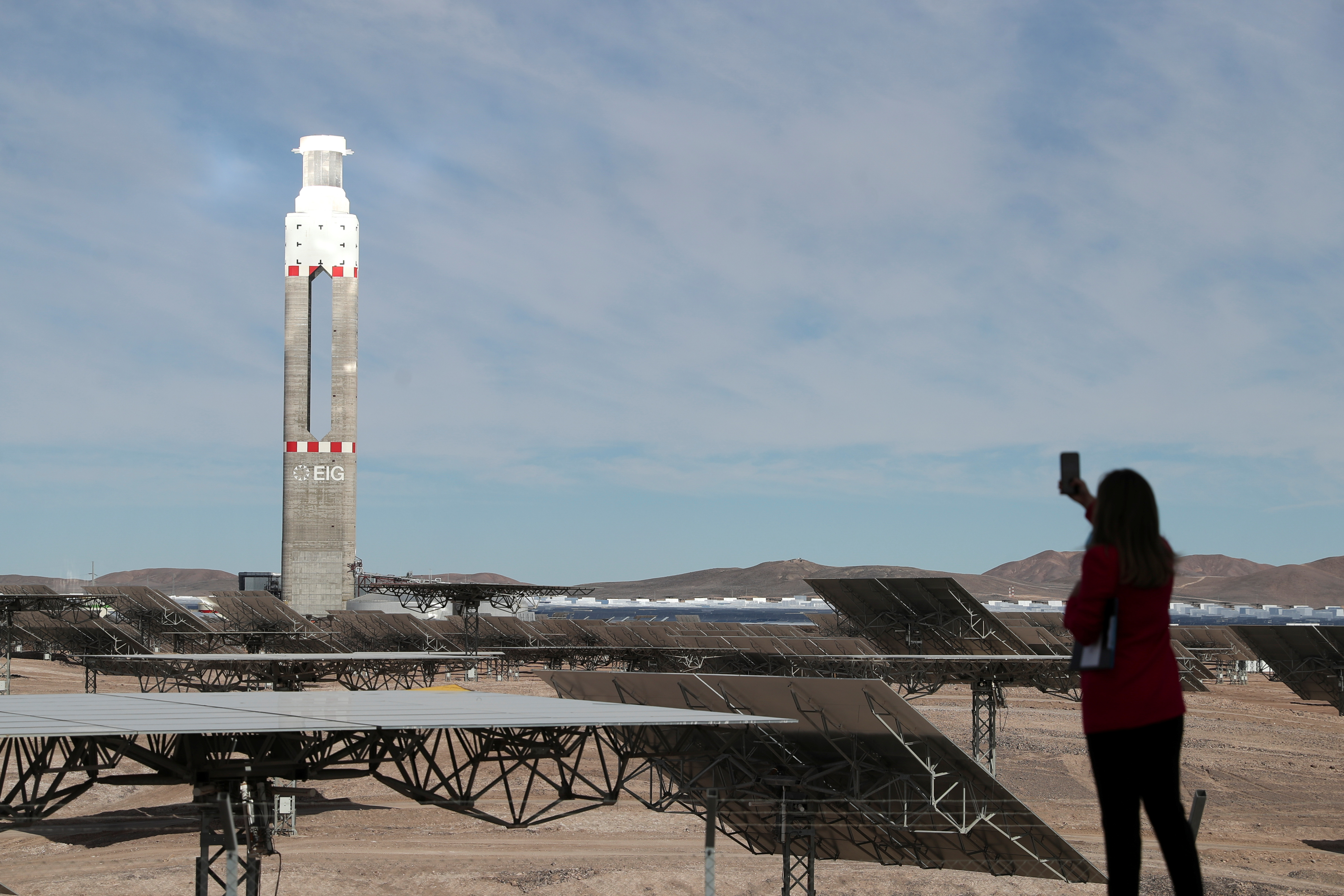 A person takes pictures during the inauguration of the Cerro Dominador thermal solar power plant, in Maria Elena, Chile June 8, 2021. REUTERS/Ivan Alvarado