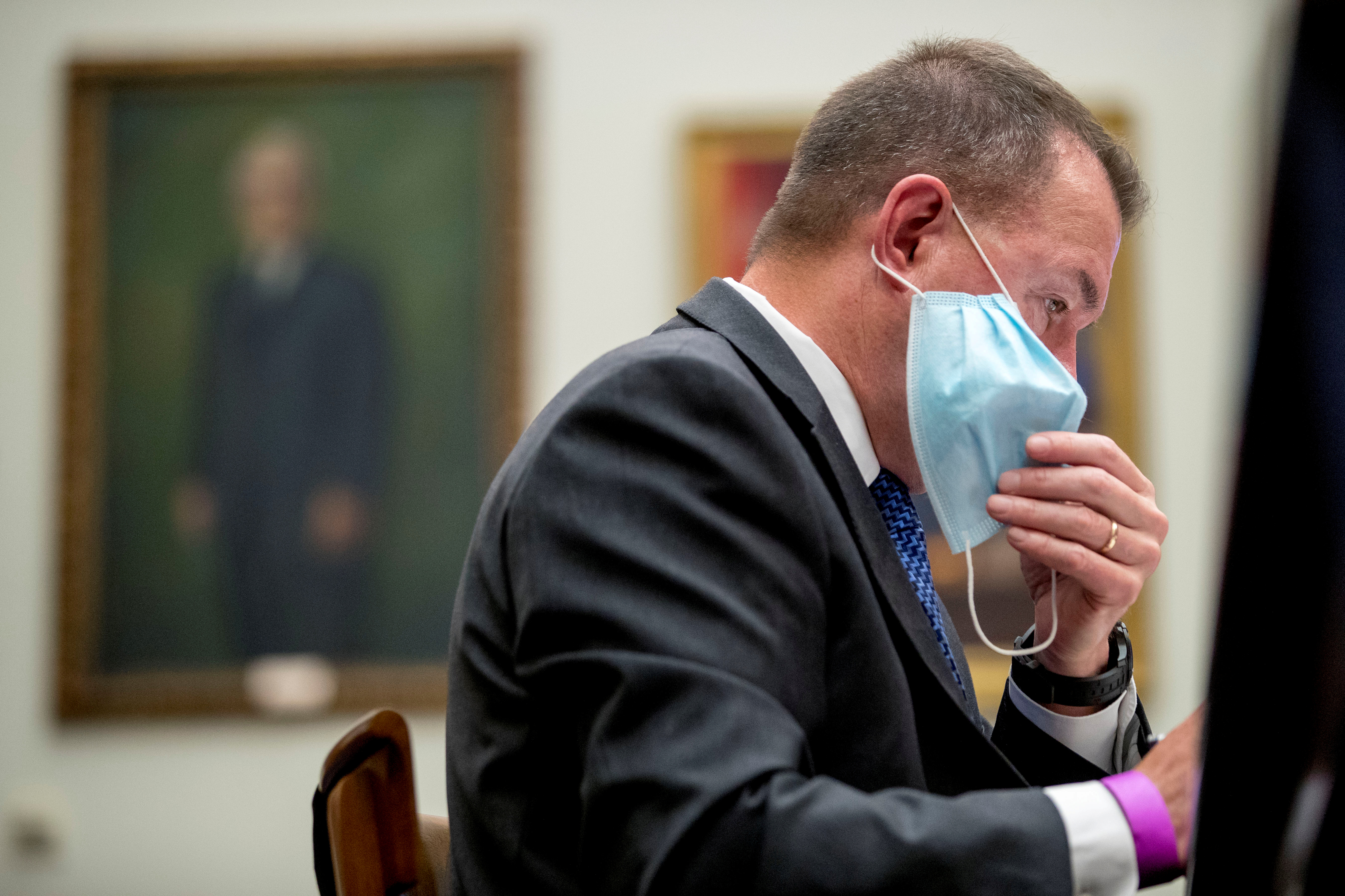 U.S. Federal Emergency Management Agency Administrator Peter Gaynor takes off his mask as he prepares to speak before the House Committee on Homeland Security meeting on the national response to the coronavirus pandemic on Capitol Hill in Washington, July 22, 2020. Andrew Harnik/Pool via REUTERS/File Photo
