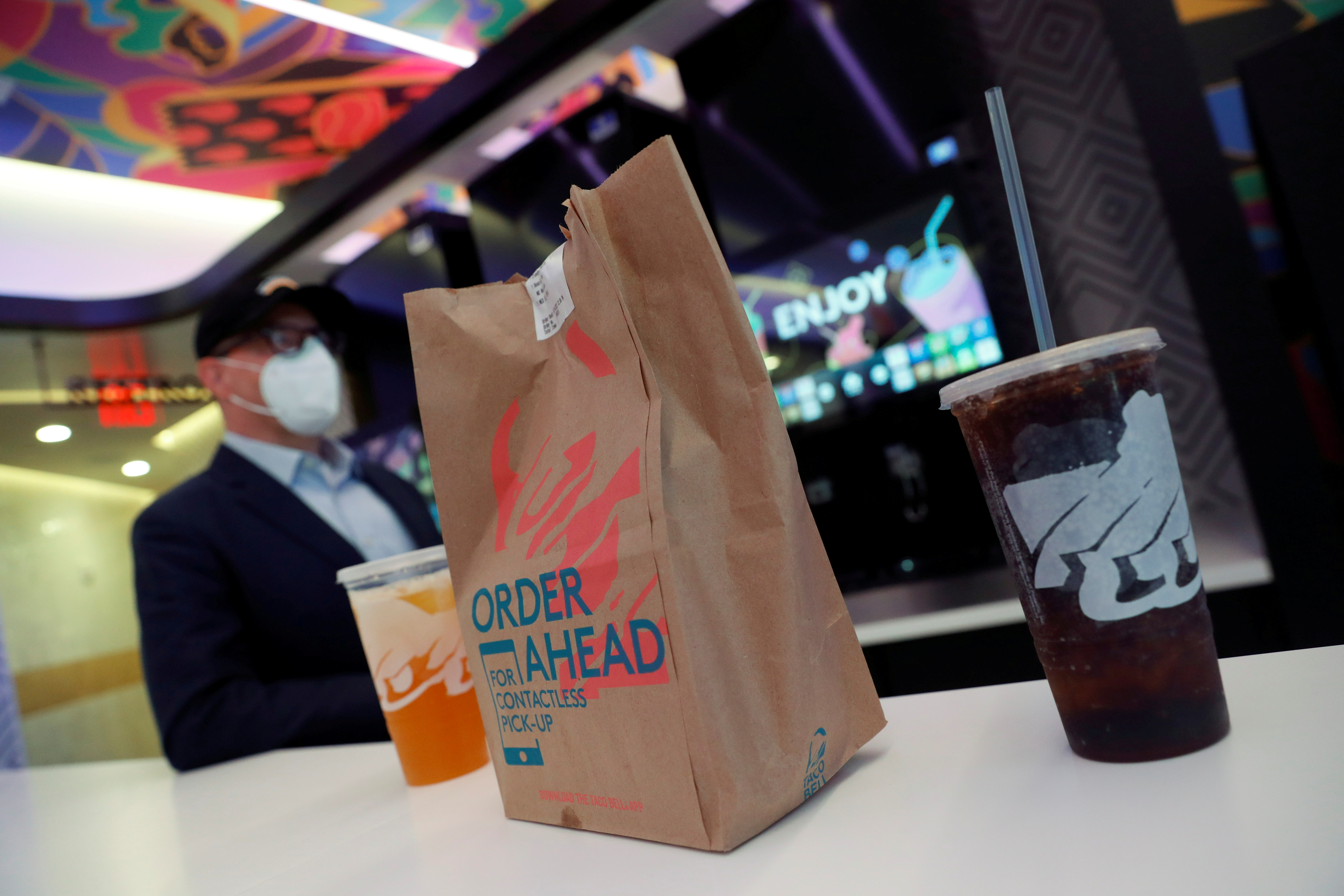 A Taco Bell order and drinks sit inside the first digital-only U.S. location at Times Square in New York City, U.S., April 14, 2021. REUTERS/Shannon Stapleton/File Photo
