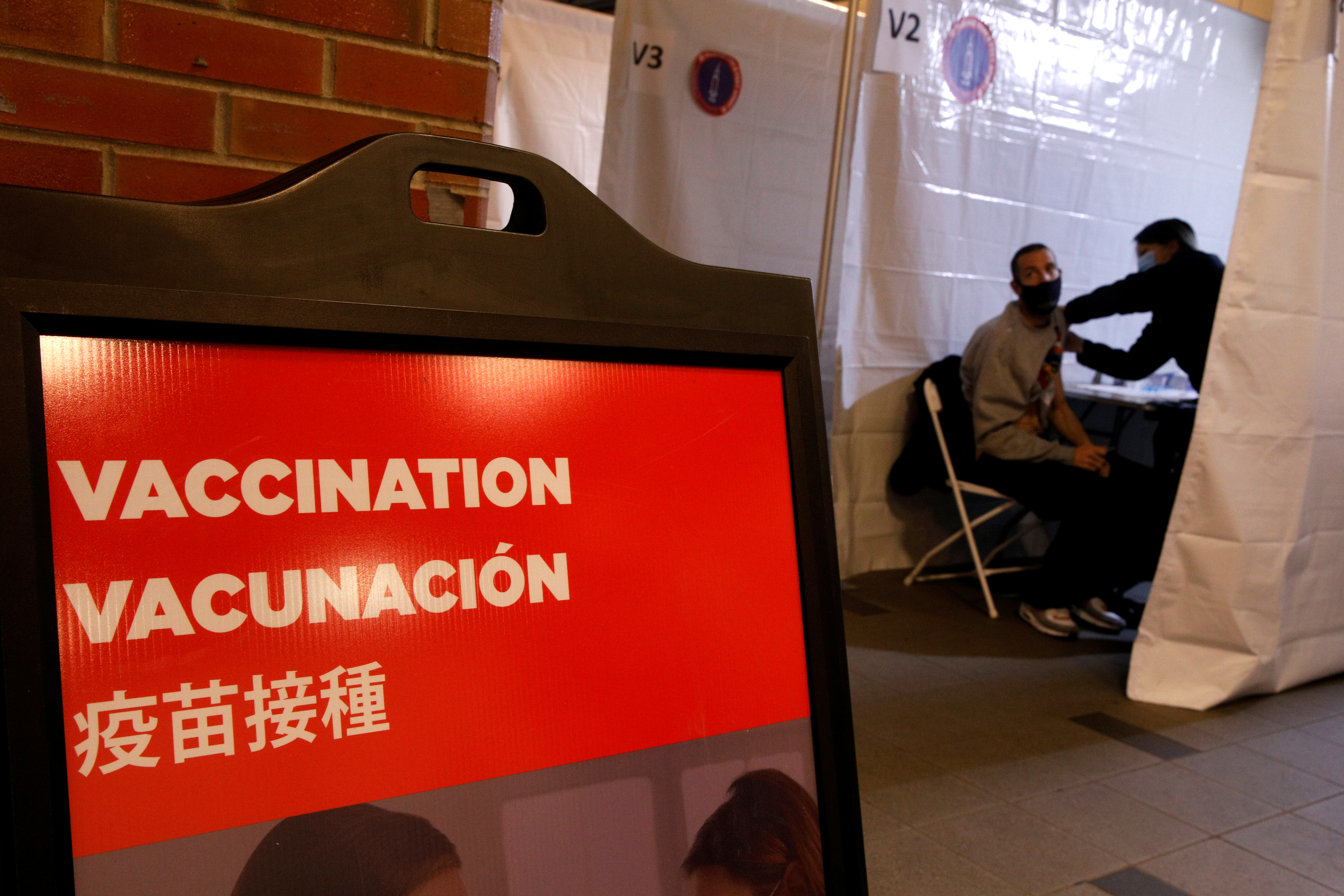 A commuter receives a shot of the Johnson & Johnson vaccine for the coronavirus disease (COVID-19) during the opening of MTA's public vaccination program at a subway station in the Brooklyn borough of New York City, New York, U.S., May 12, 2021. REUTERS/Brendan McDermid/File Photo
