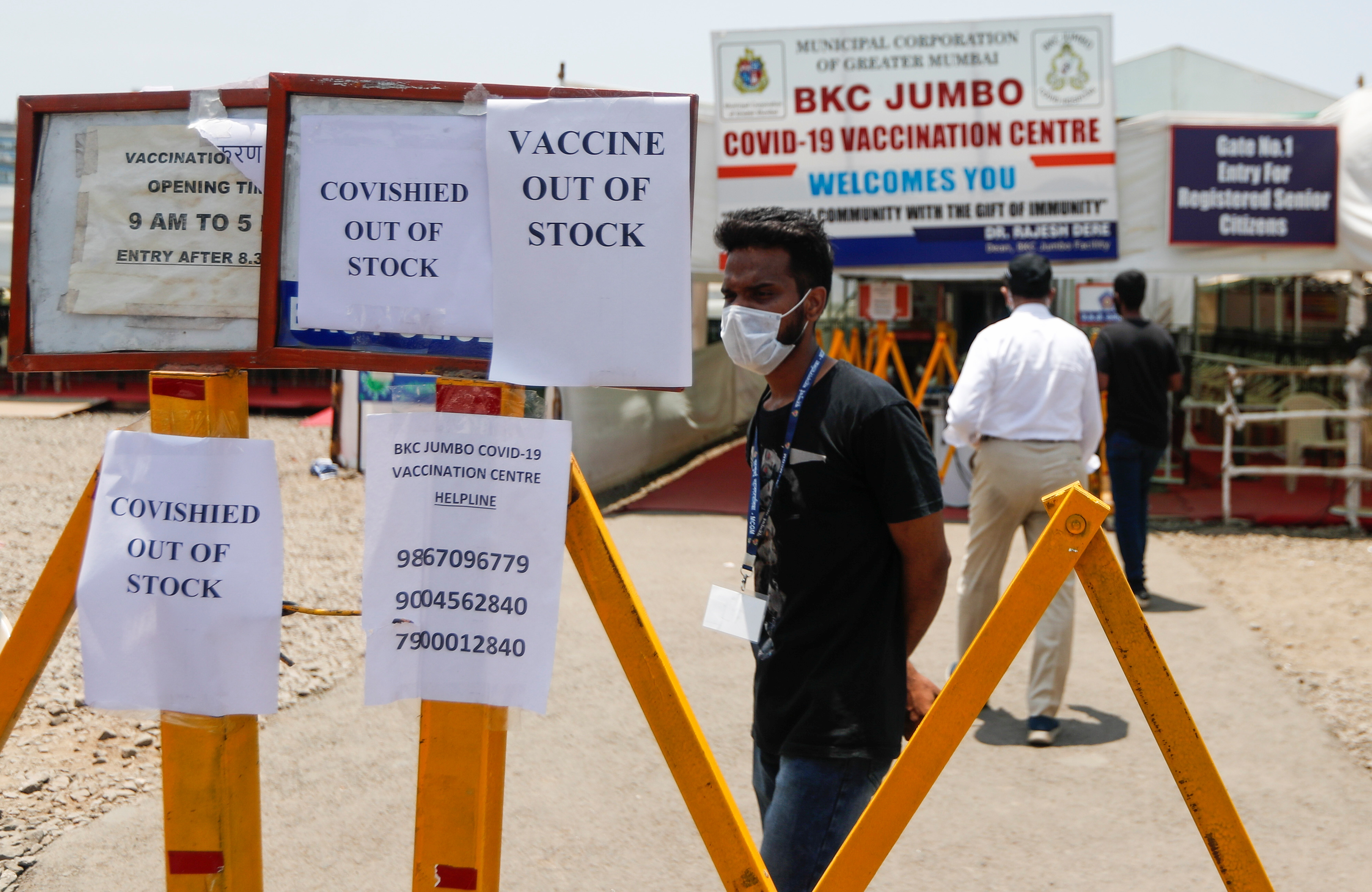 Notices about the shortage of COVISHIELD, a coronavirus disease (COVID-19) vaccine manufactured by Serum Institute of India, are seen outside a COVID-19 vaccination centre in Mumbai, India, April 20, 2021. REUTERS/Francis Mascarenhas