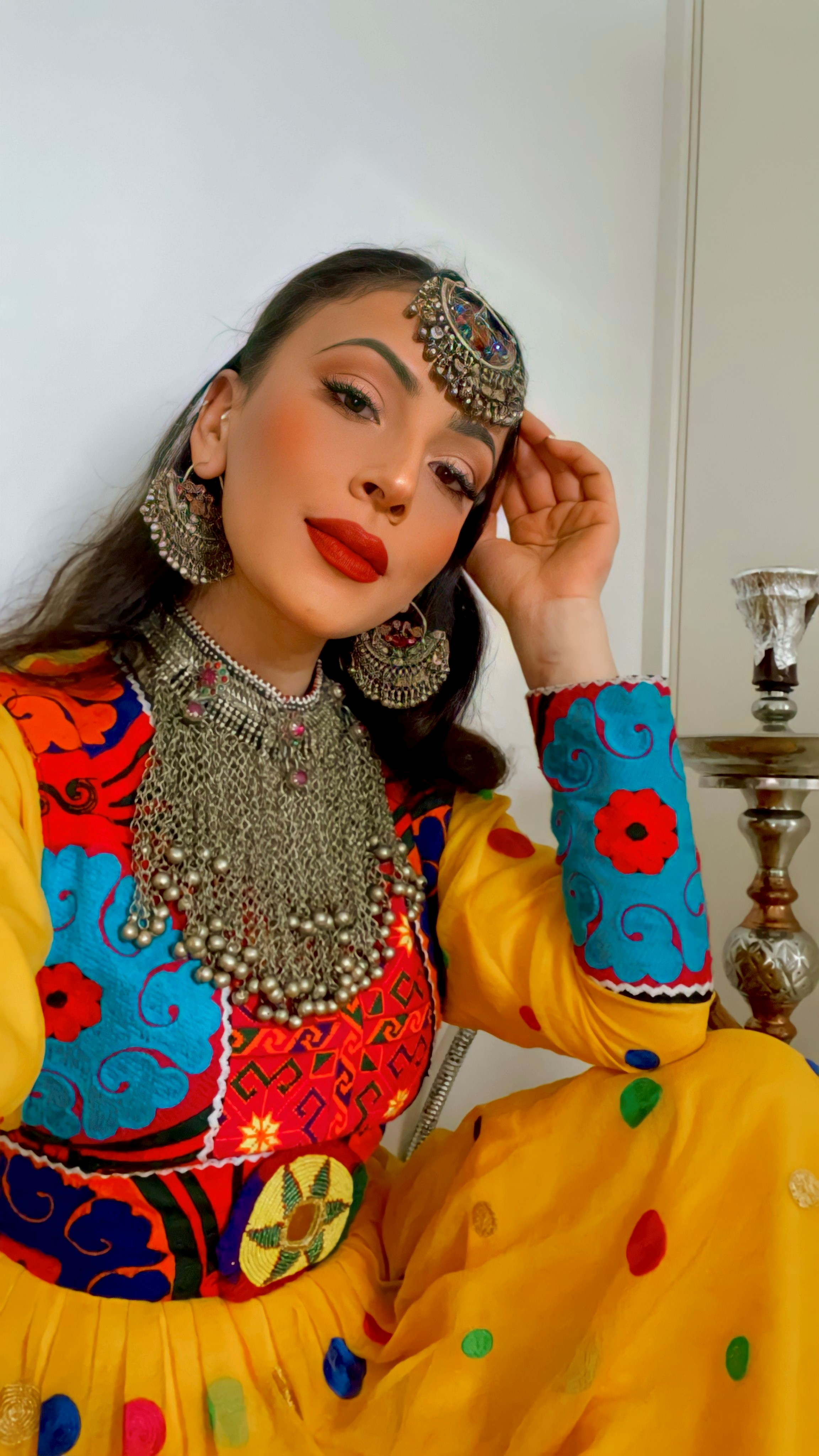 A woman poses in traditional Afghan attire, in Stavanger, Norway, September 12, 2021, in this picture obtained from social media. Sophia Moruwat/via REUTERS