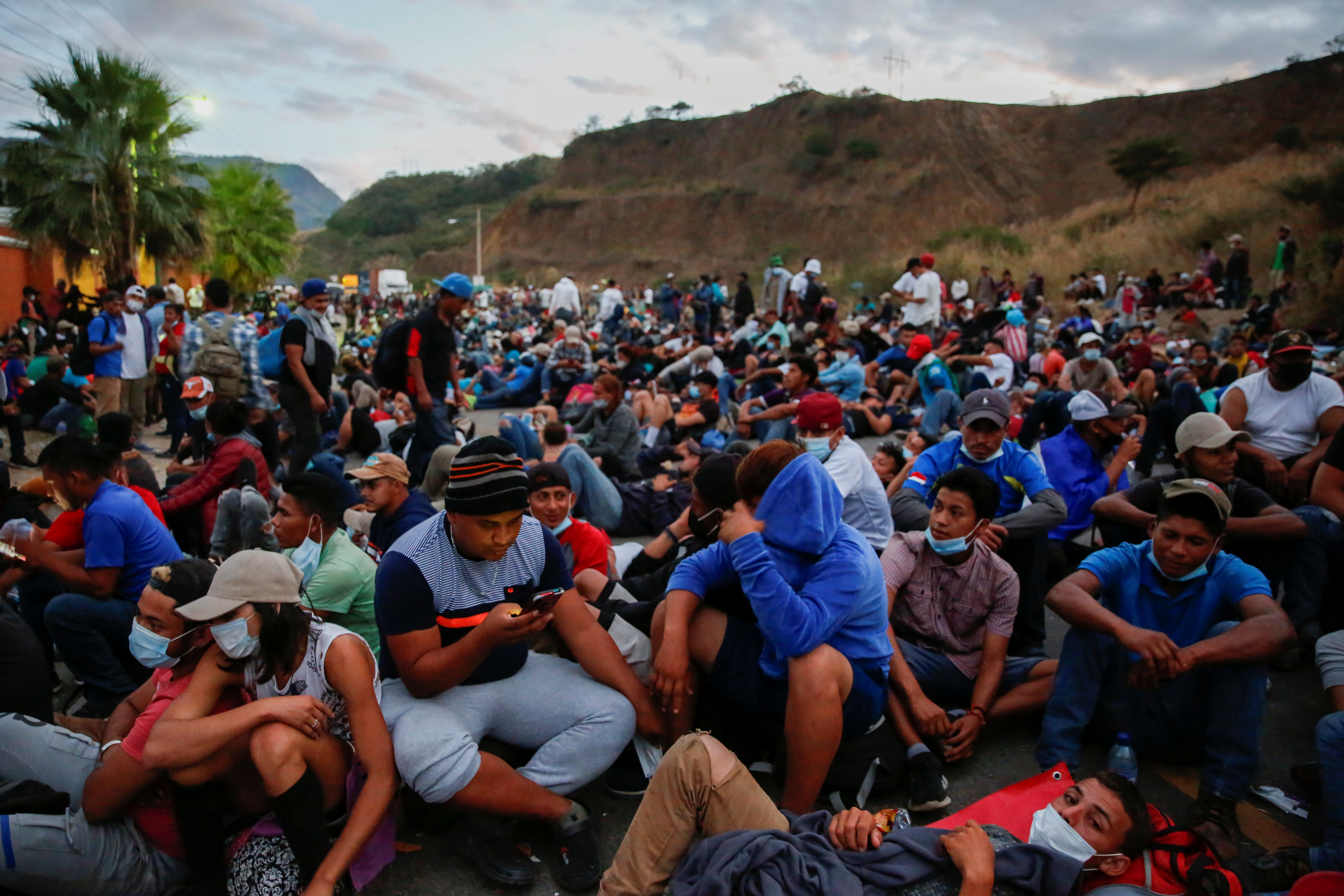 Hondurans taking part in a new caravan of migrants, set to head to the United States, rest on a road, in Vado Hondo, Guatemala January 17, 2021. REUTERS/Luis Echeverria