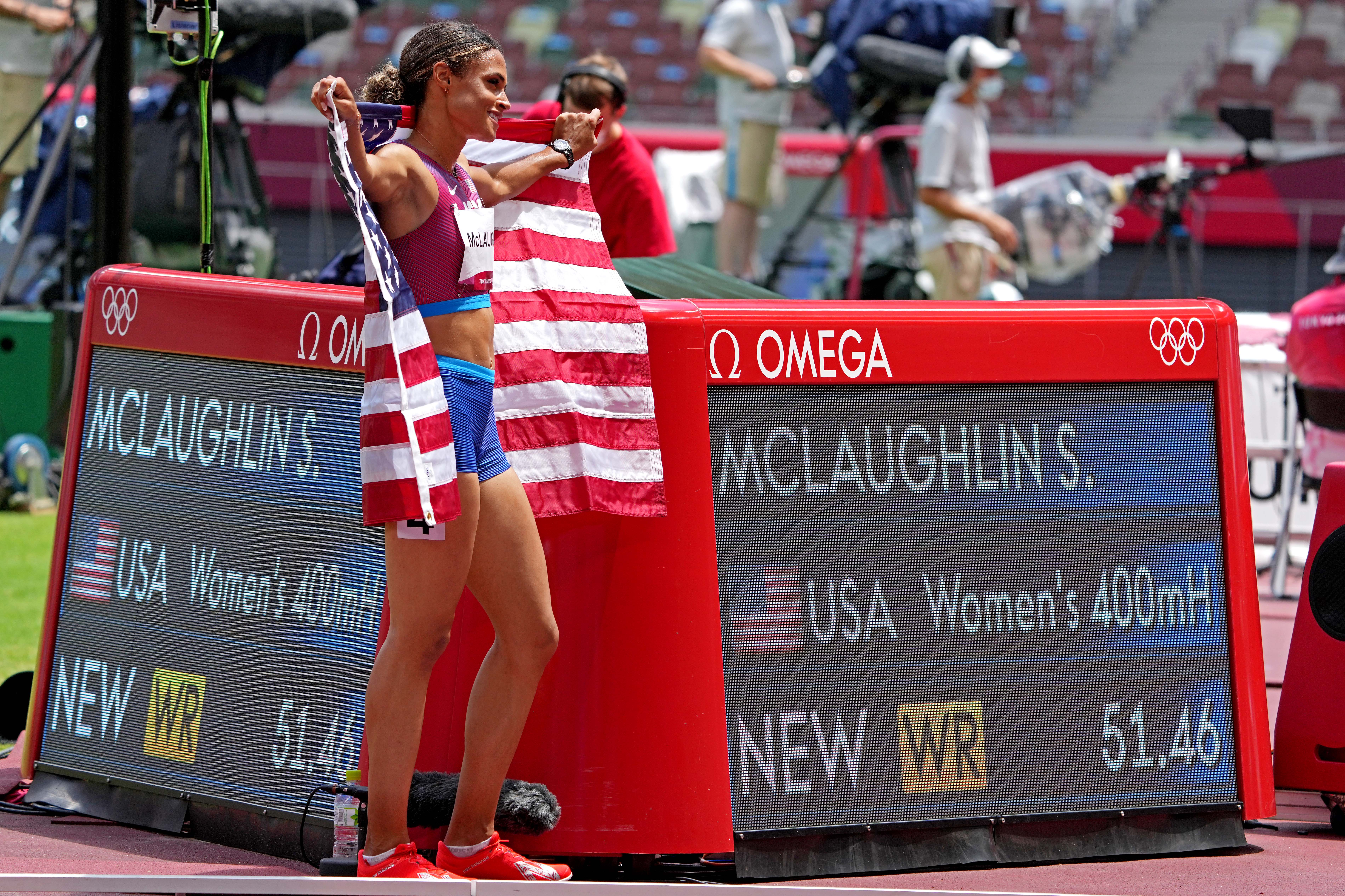 Aug 4, 2021; Tokyo, Japan; Sydney McLaughlin (USA) celebrates winning the gold medal in the women's 400m hurdles final in a world record time during the Tokyo 2020 Olympic Summer Games at Olympic Stadium. Mandatory Credit: Kirby Lee-USA TODAY Sports
