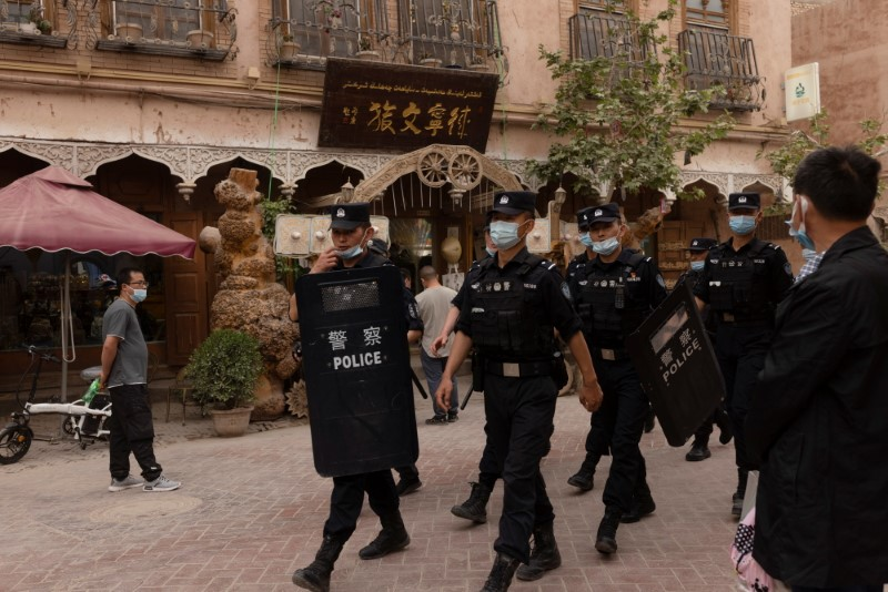 Police officers patrol in the old city in Kashgar, Xinjiang Uyghur Autonomous Region, China, May 4, 2021. REUTERS/Thomas Peter