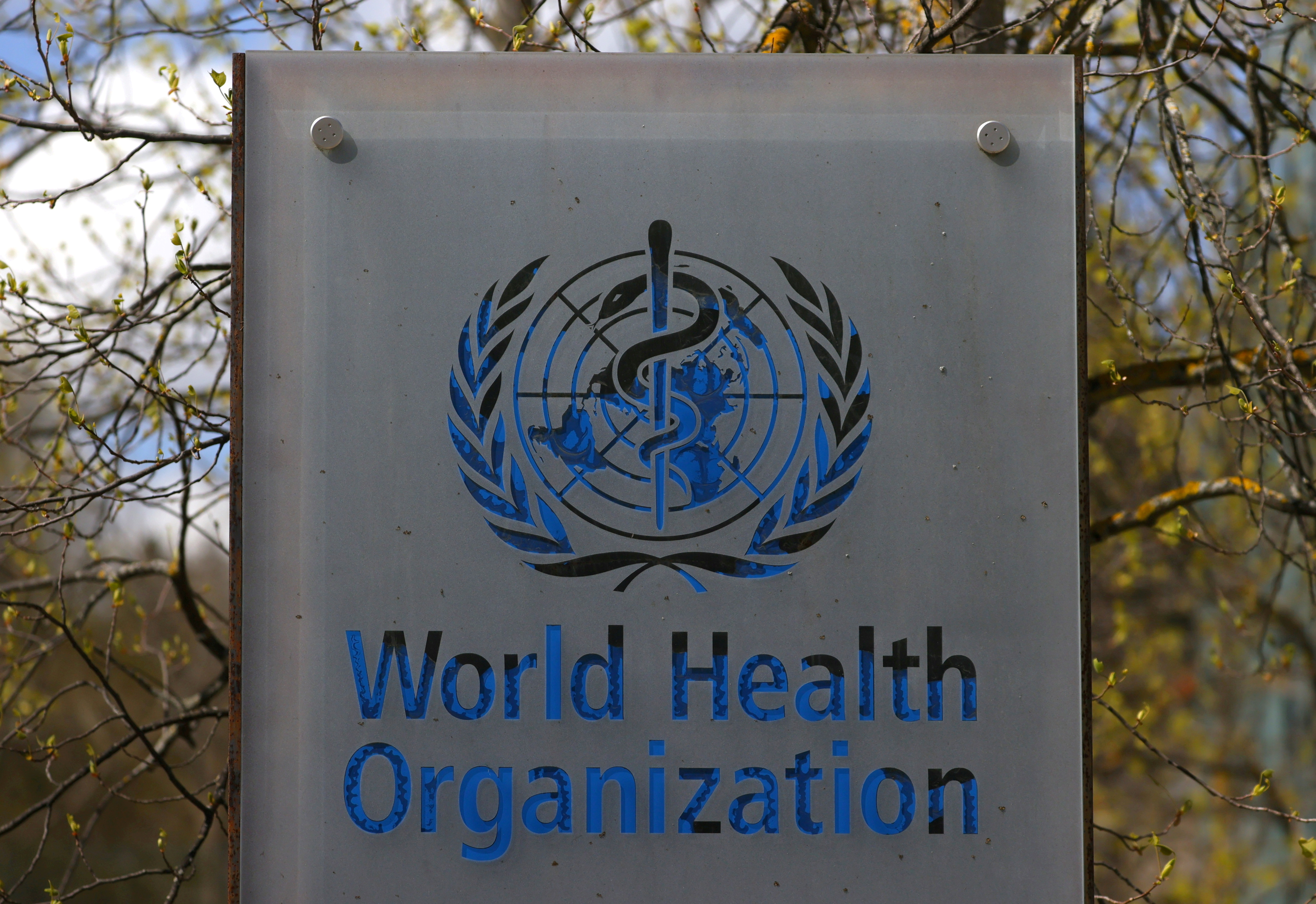 A logo is pictured outside a building of the World Health Organization (WHO) during an executive board meeting on update on the coronavirus disease (COVID-19) outbreak, in Geneva, Switzerland, April 6, 2021. REUTERS/Denis Balibouse